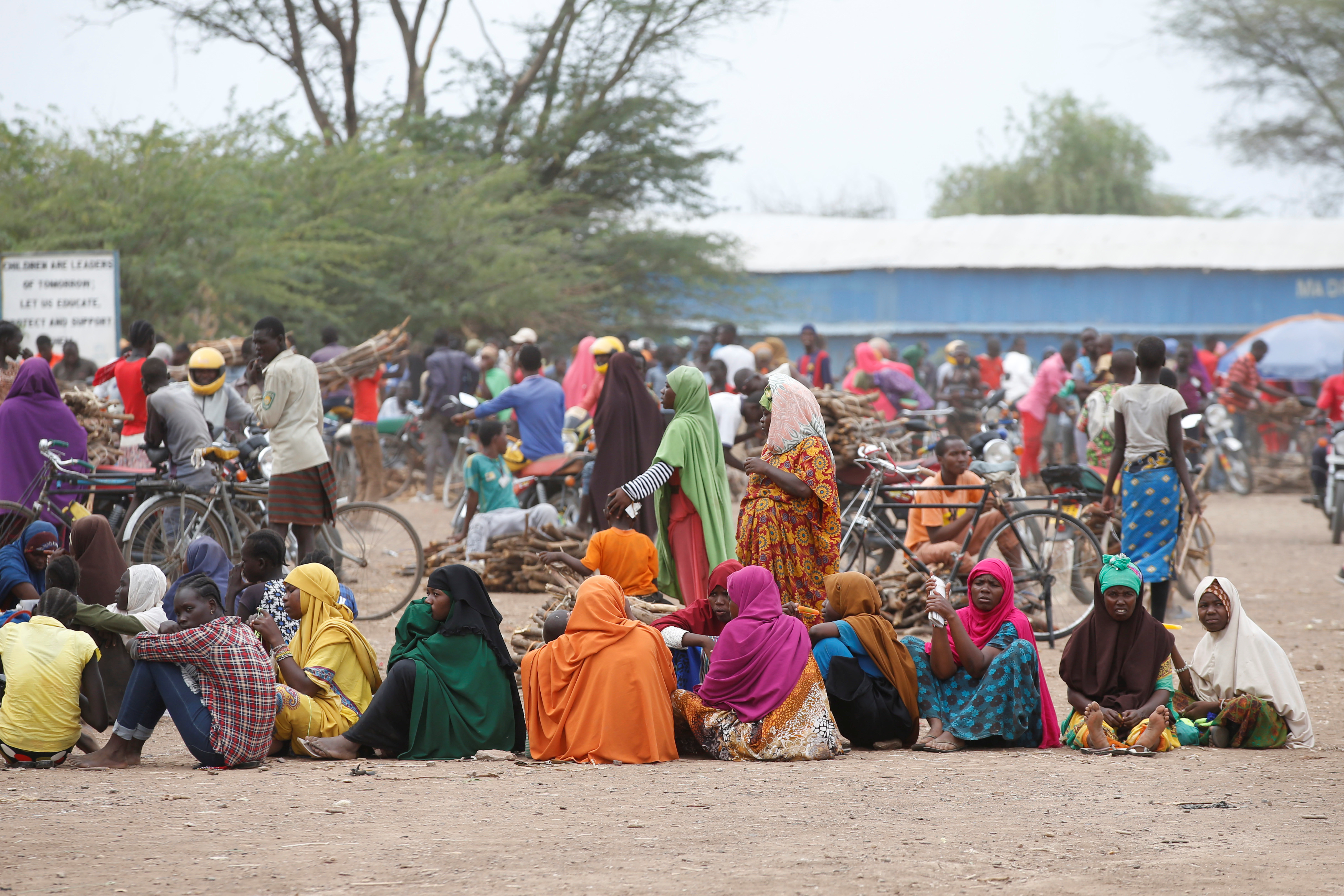 Women wait in line to receive aid at the Kakuma refugee camp in northern Kenya, March 6, 2018.