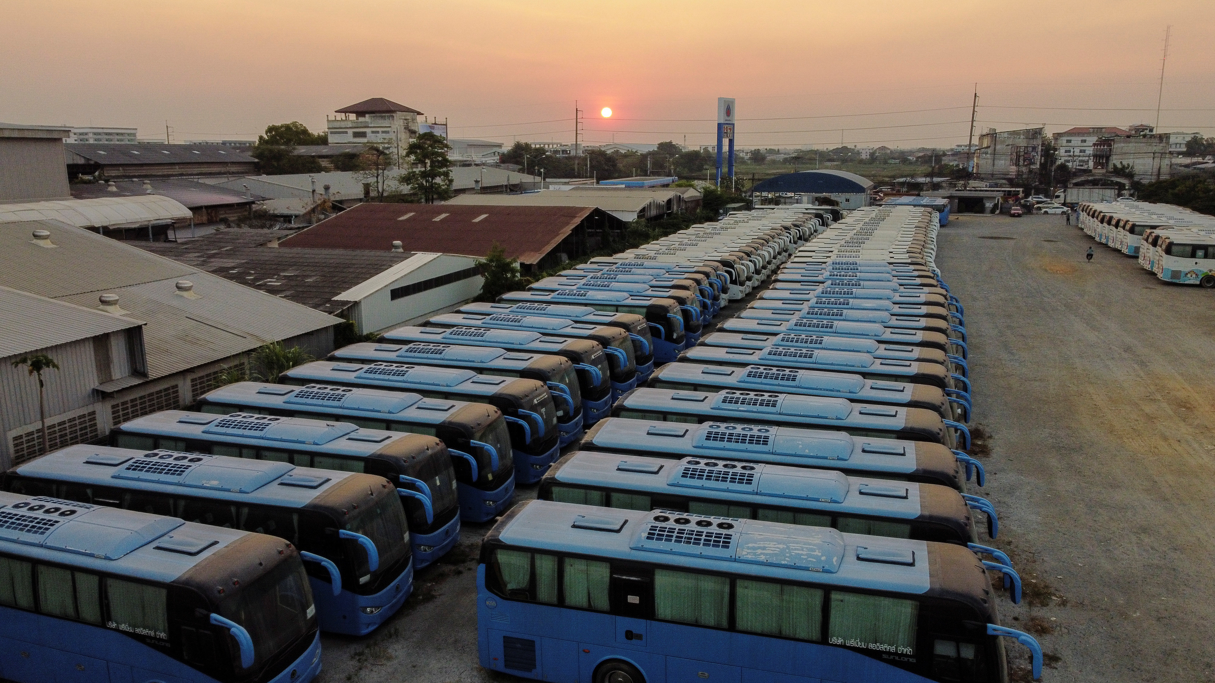 Buses that used to transport Chinese tourists around Thailand are seen idle due to travel bans and border closures from the global coronavirus disease (COVID-19) outbreak in a parking lot near Suvarnabhumi airport in Bangkok, Thailand February 5, 2021. Picture taken with a drone on February 5, 2021.