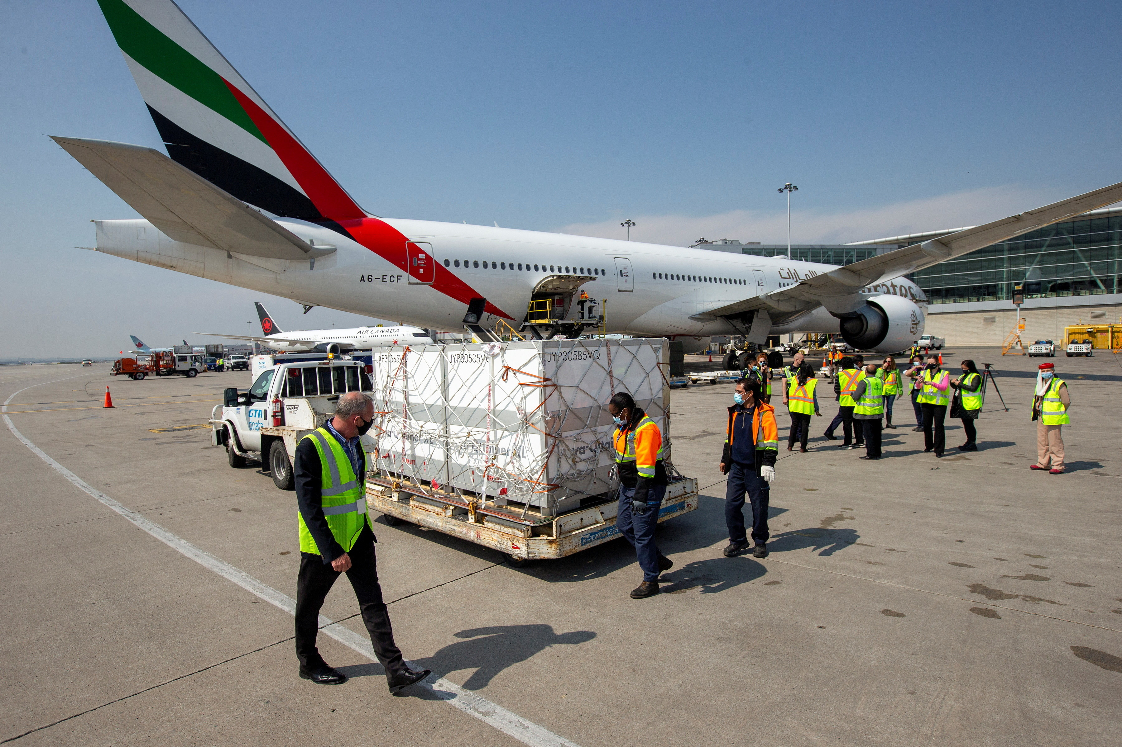 Ground crew unload a shipment from South Africa of the Johnson & Johnson vaccine against the coronavirus disease (COVID-19) at Toronto Pearson Airport in Mississauga, Ontario, Canada April 28, 2021. REUTERS/Carlos Osorio - RC235N9ADHGI