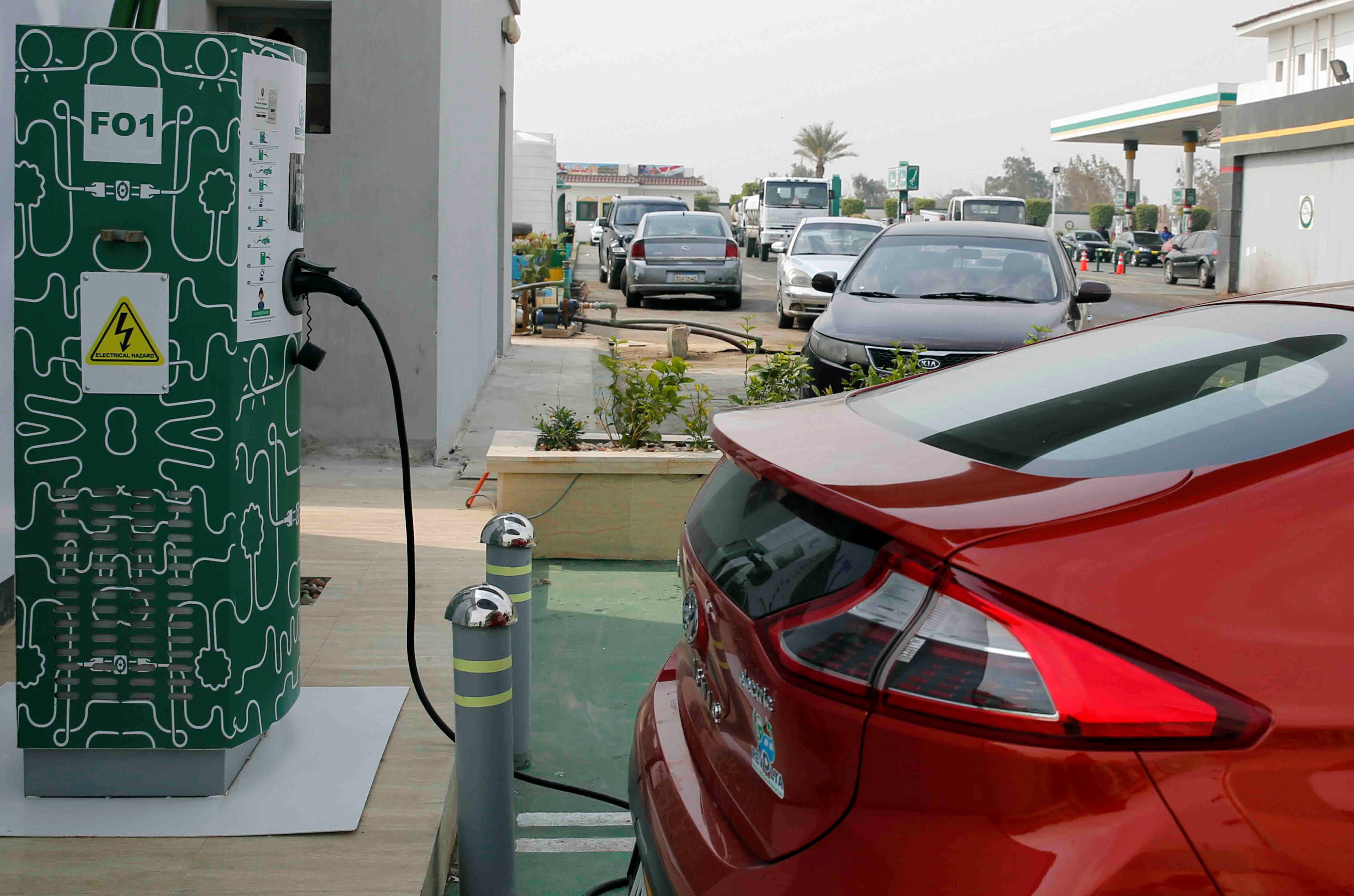 An electric car charging box is seen with Hyundai's Ioniq as an effort to reduce fuel consumption and gradually decrease the country's carbon footprint, at Revolta charging station in Cairo, Egypt, February 19, 2018. Picture taken February 19, 2018. REUTERS/Amr Abdallah Dalsh - RC11DBB32060