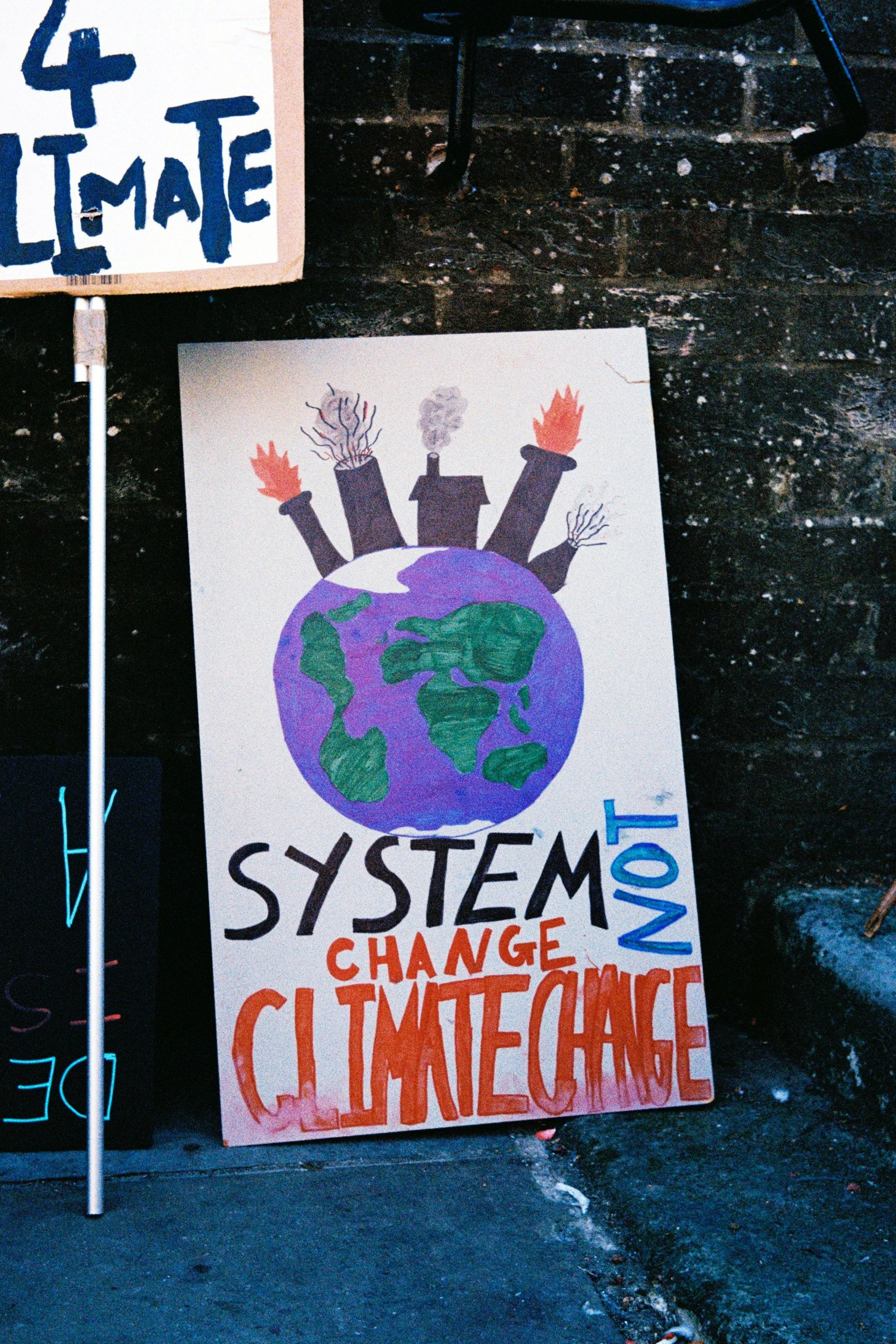 system change not climate change card