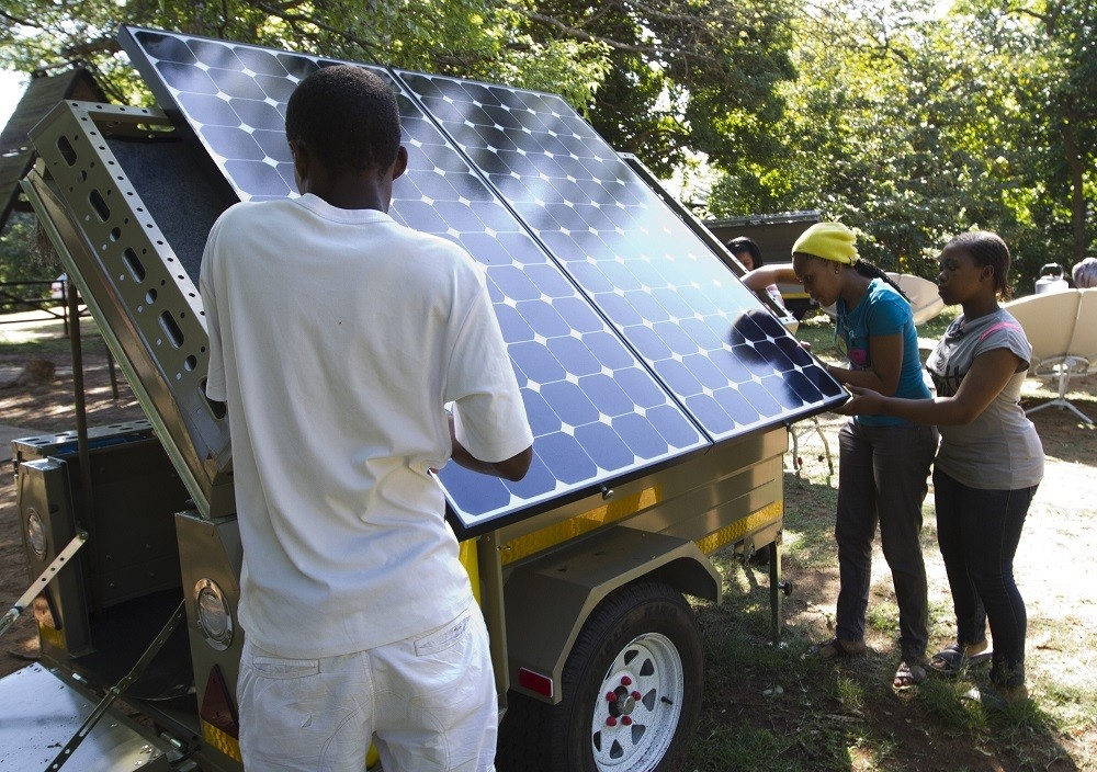 Scouts participate in a Greenpeace workshop in Durban, October 4, 2011. The scouts are learning about renewable energy and are preparing two trailers equipped with solar panels and a wind turbine which will be used to educate young people ahead of the 17th Conference of the Parties (COP17) to the United Nations Framework Convention on Climate Change (UNFCCC). REUTERS/Rogan Ward (SOUTH AFRICA - Tags: EDUCATION ENERGY ENVIRONMENT) - GM1E7A502EQ01