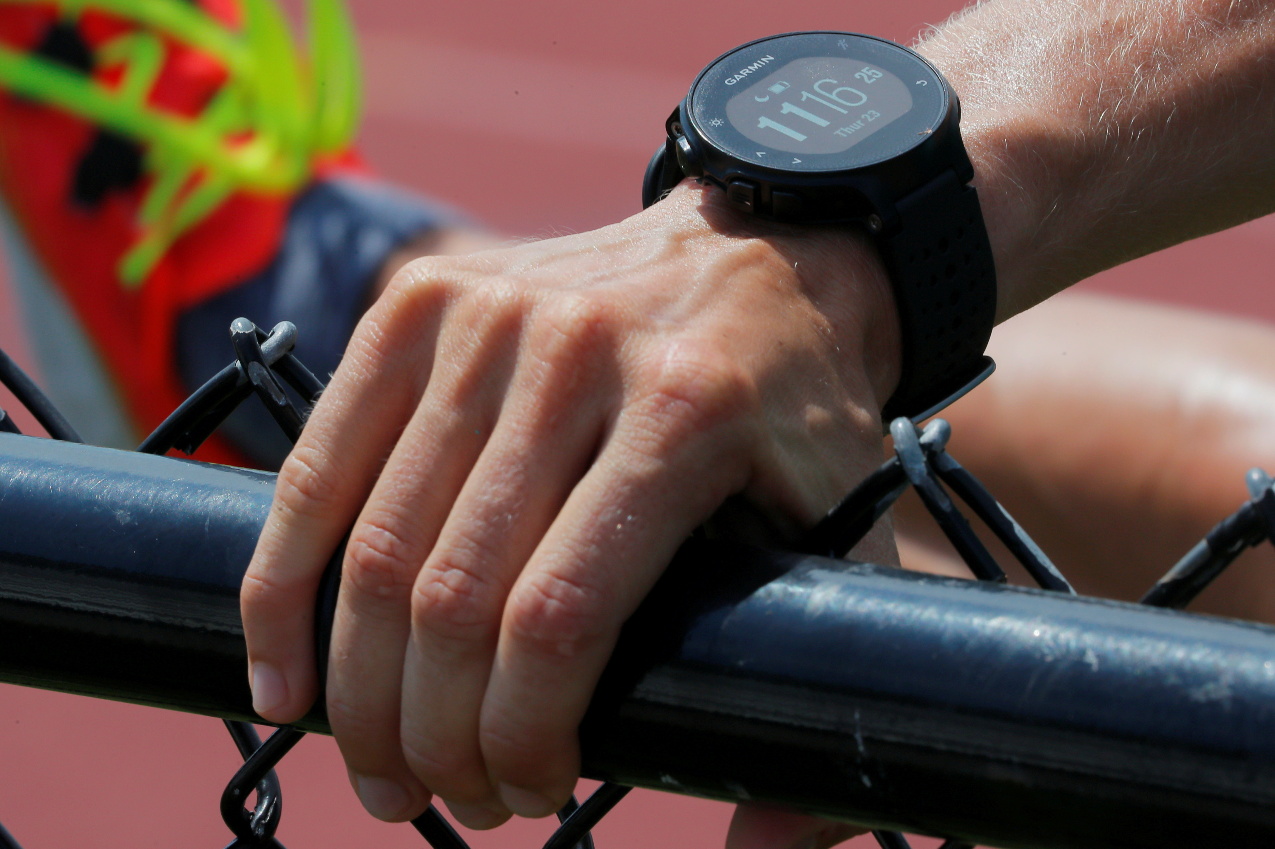 A runner wearing a Garmin smart watch, a device which some experts are studying to determine if it might be used to help detect early coronavirus disease (COVID-19) infection.