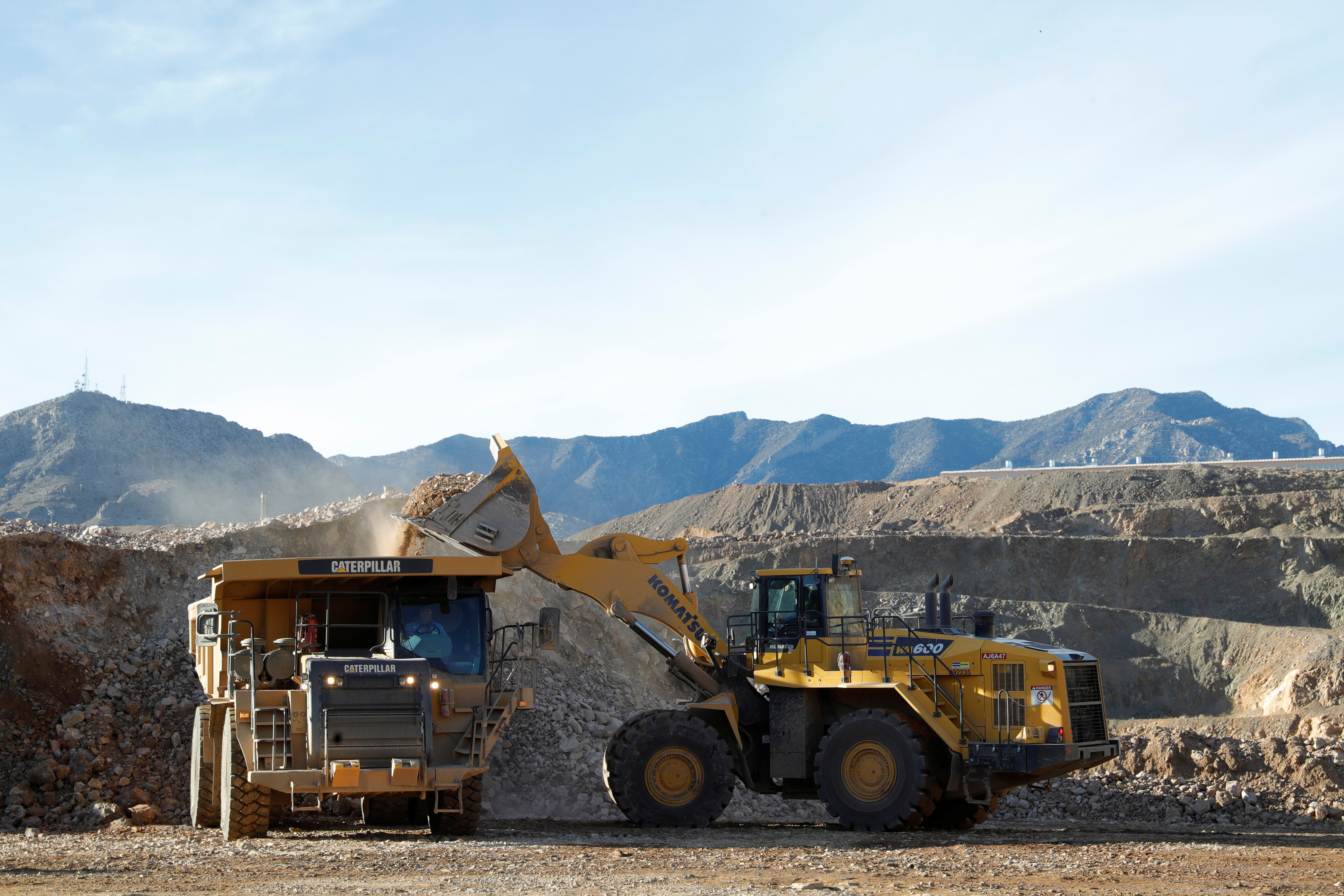 A wheel loader operator fills a truck with ore at the MP Materials rare earth mine in Mountain Pass, California, U.S. January 30, 2020