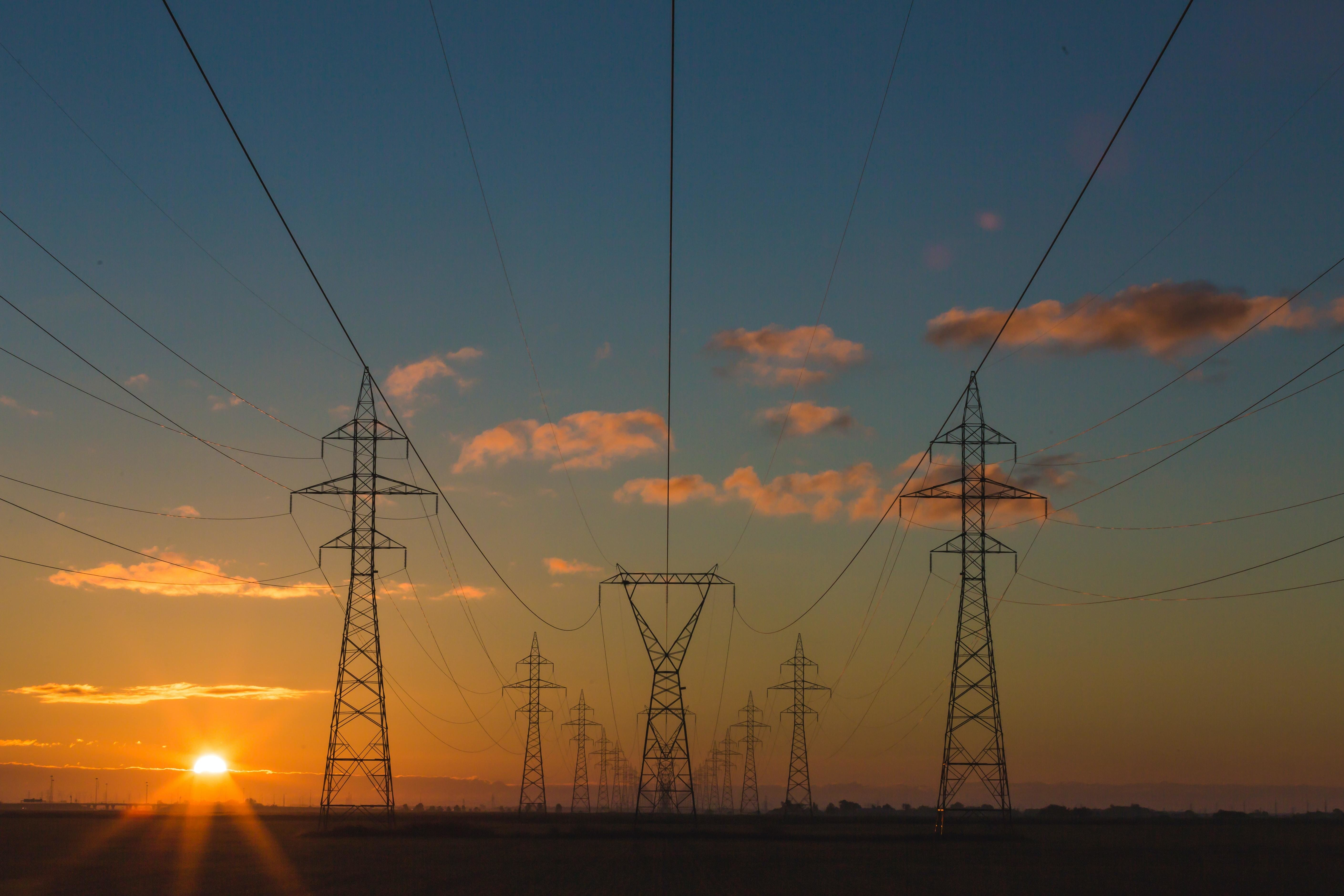 pylons infront of a sunset