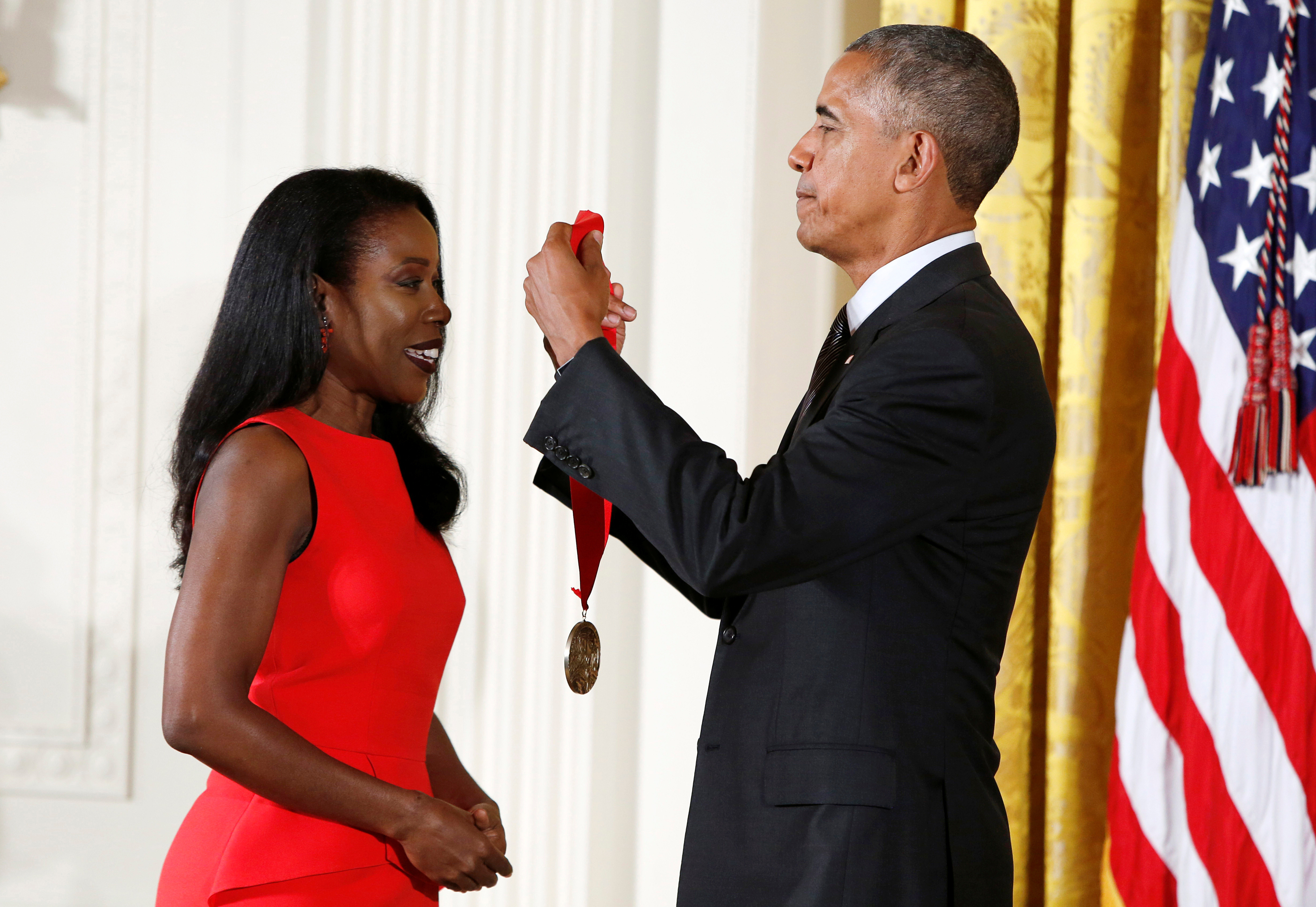 U.S. President Barack Obama awards to journalist Isabel Wilkerson (L) at the White House