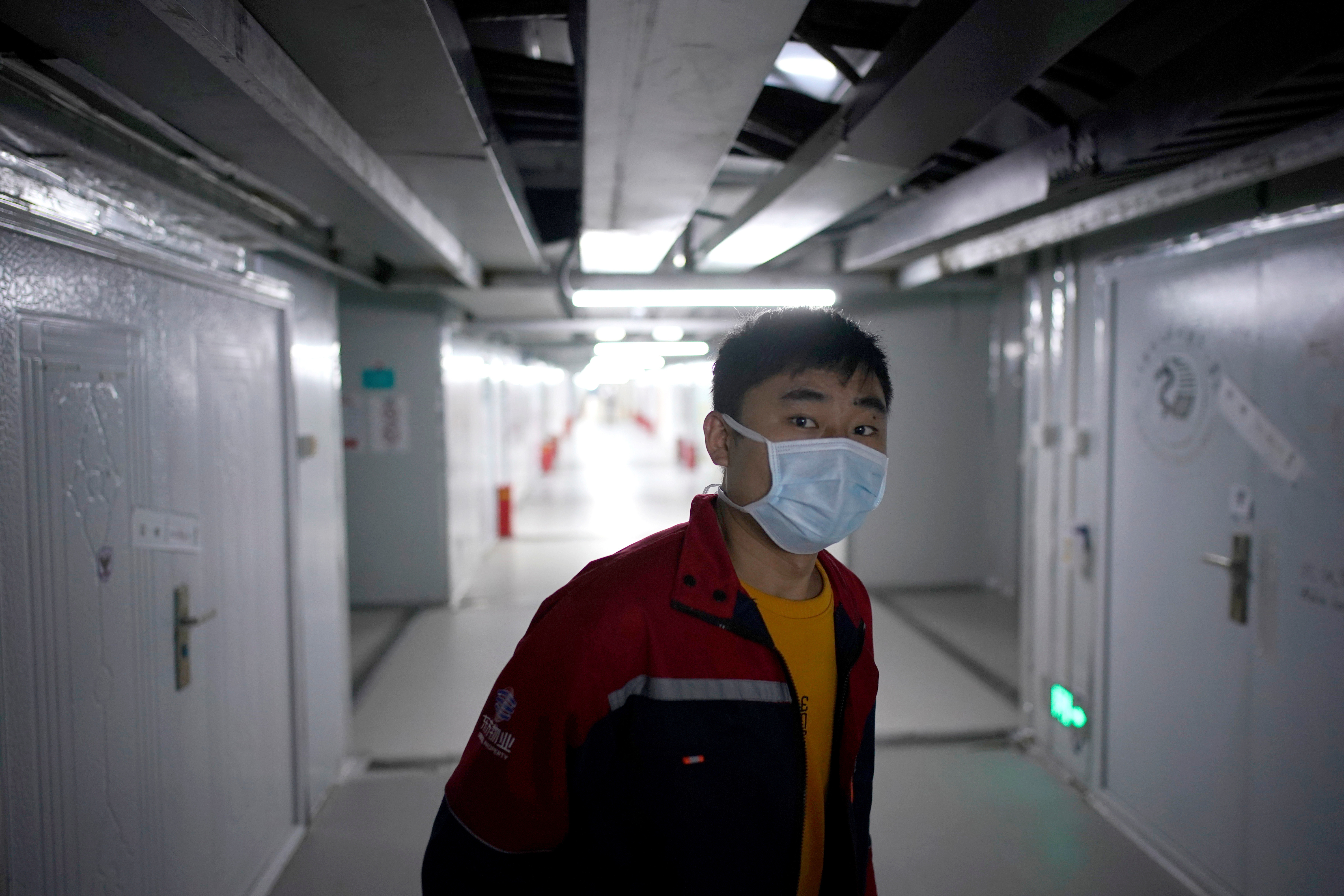 A staff member wearing a face mask is seen near closed wards inside the Leishenshan Hospital, a makeshift hospital for treating patients with the coronavirus disease (COVID-19), in Wuhan, Hubei province, China April 11, 2020. REUTERS/Aly Song - RC242G9XKX57