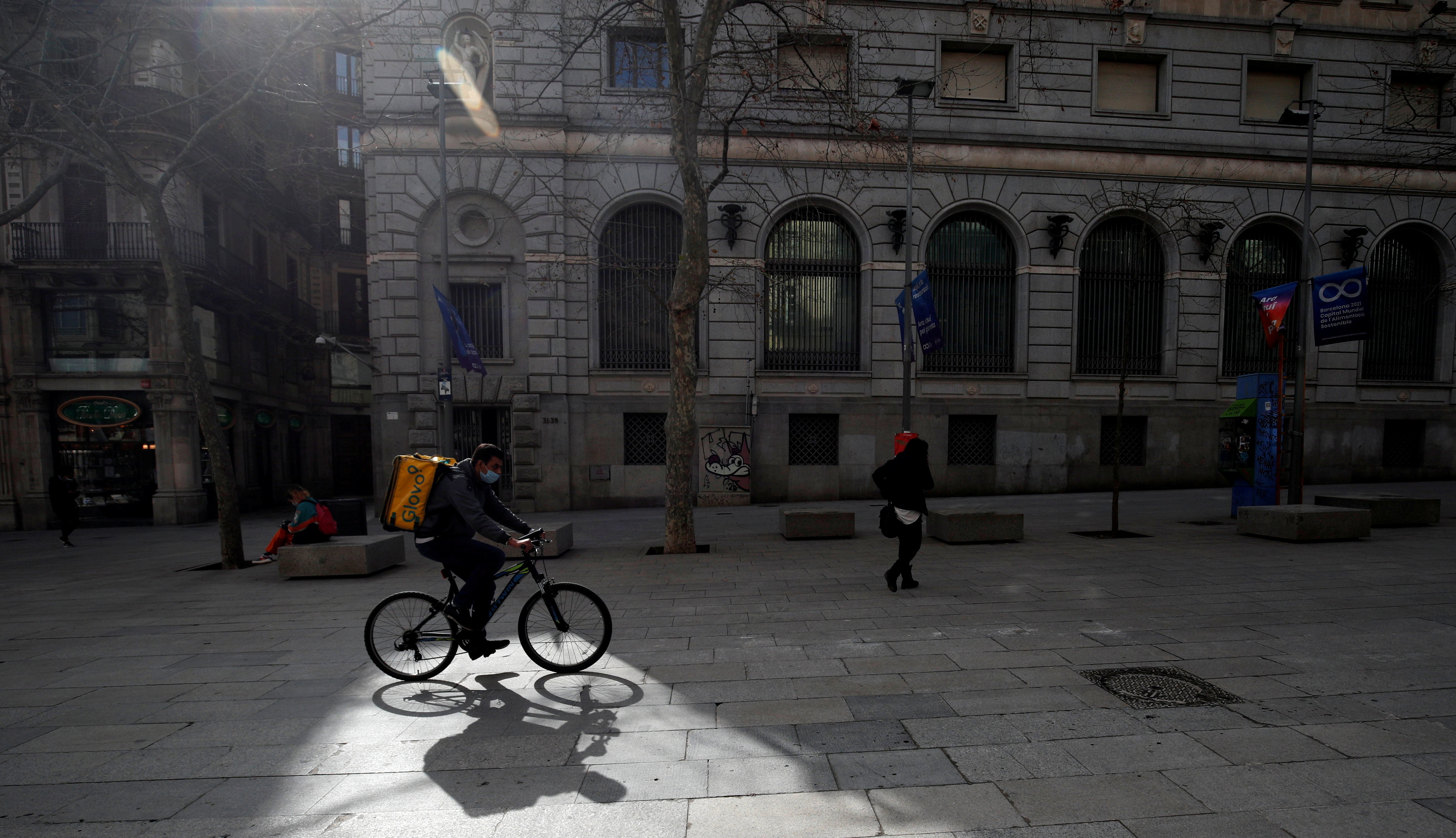 Glovo deliver rider passes through a pedestrian area in Barcelona, Spain, February 23, 2021. Picture taken on February 23, 2021. REUTERS/ Albert Gea     TPX IMAGES OF THE DAY - RC2M3M959G33