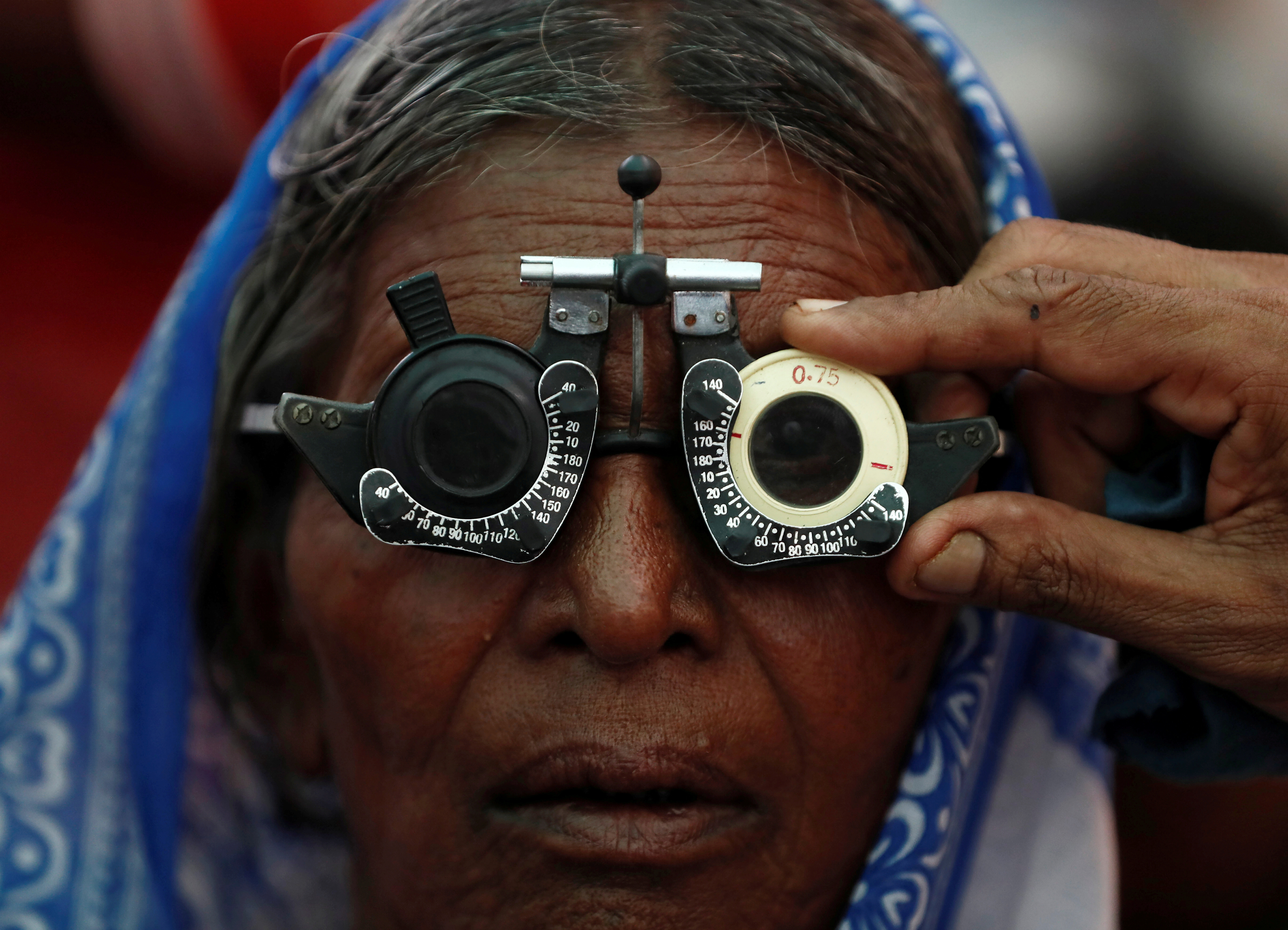 A woman gets her eyes tested at a free eye-care camp on the occasion of Indian politician Babasaheb Ambedkar's death anniversary in Mumbai, India, December 6, 2019. REUTERS/Francis Mascarenhas