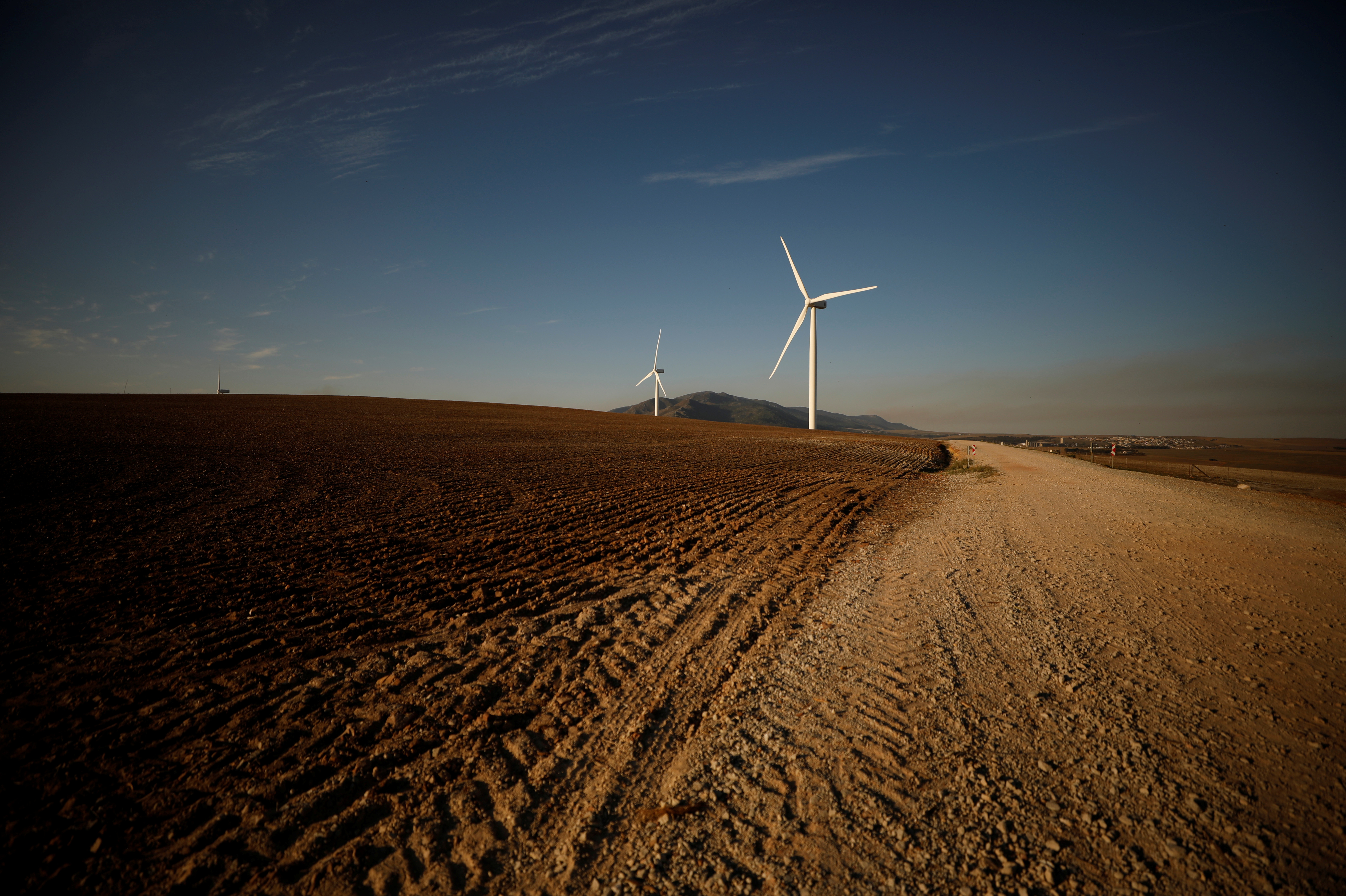 Wind turbines produce renewable energy outside Caledon, South Africa, May 20, 2020. Picture taken May 20, 2020. REUTERS/Mike Hutchings - RC272H90E73R