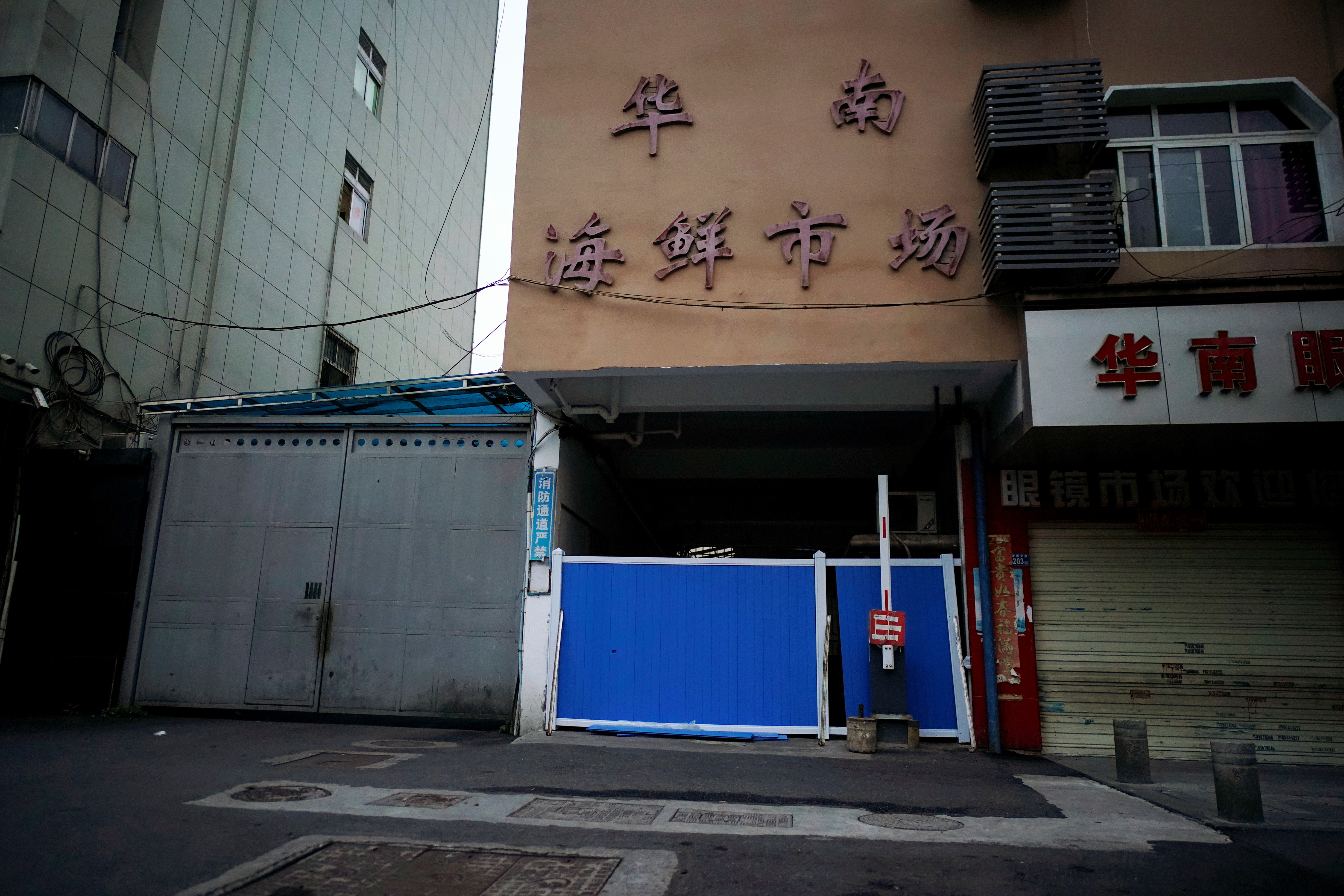 A blocked entrance to Huanan seafood market, where the coronavirus that can cause COVID-19 is believed to have first surfaced, is seen in Wuhan, Hubei province, China March 30, 2020.