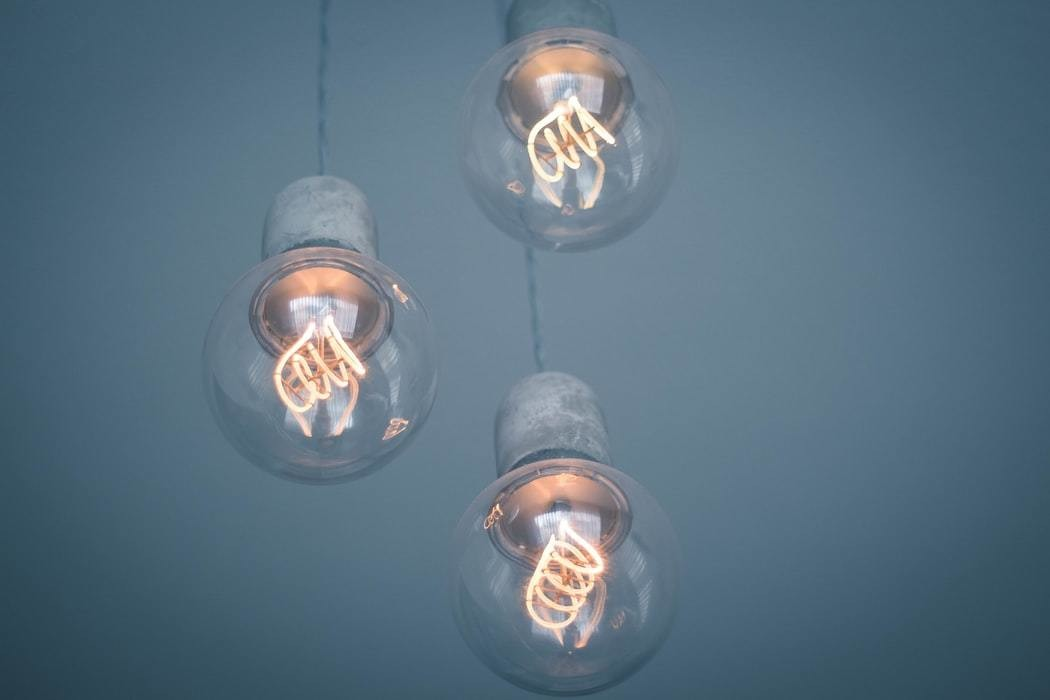 Three lightbulb are pictured