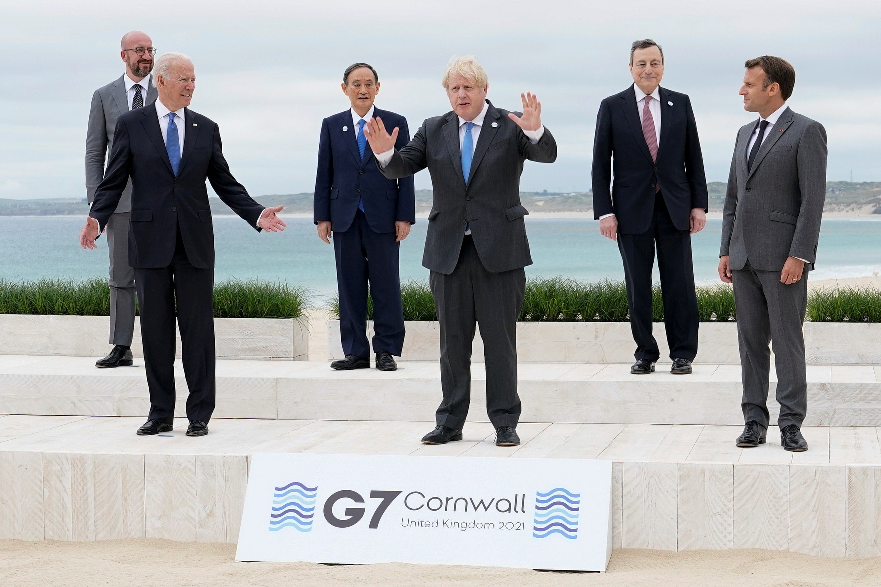 U.S. President Joe Biden and British Prime Minister Boris Johnson gesture as they pose for a family photo with G-7 leaders; European Council President Charles Michel, Japan's Prime Minister Yoshihide Suga, Italy's Prime Minister Mario Draghi and French President Emmanuel Macron at the G-7 summit, in Carbis Bay, Cornwall, Britain June 11, 2021. Patrick Semansky/Pool via REUTERS     TPX IMAGES OF THE DAY - RC2DYN9SX06W