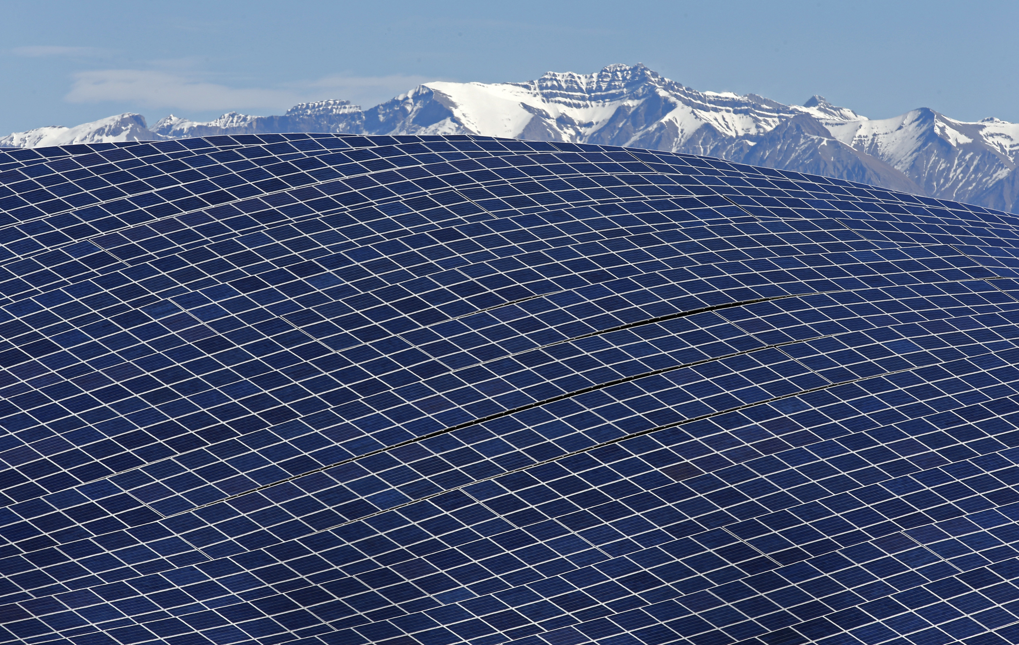A general view shows solar panels to produce renewable energy at the photovoltaic park in Les Mees, in the department of Alpes-de-Haute-Provence, southern France March 31, 2015. The solar farm of the Colle des Mees, the biggest in France, consists of 112,780 solar modules covering an area of 200 hectares of land and representing 100 MW of power