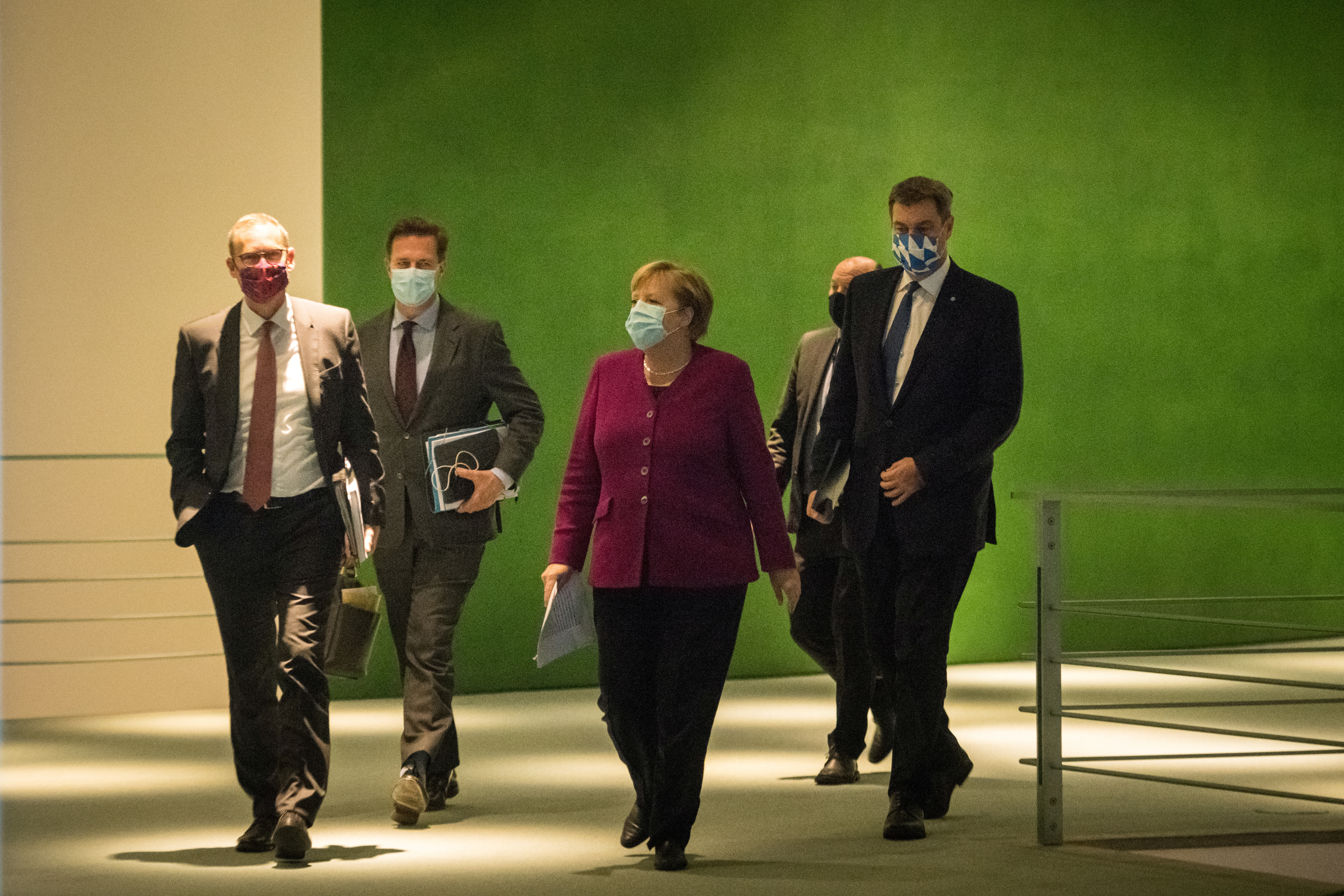 German Chancellor Angela Merkel , Bavaria's State Premier Markus Soeder and Berlin's mayor Michael Mueller arrive to give a press conference after a meeting of states' leaders on the coronavirus situation in Berlin on October 14, 2020. Stefanie Loos/Pool via REUTERS - RC2MIJ9ZNK58