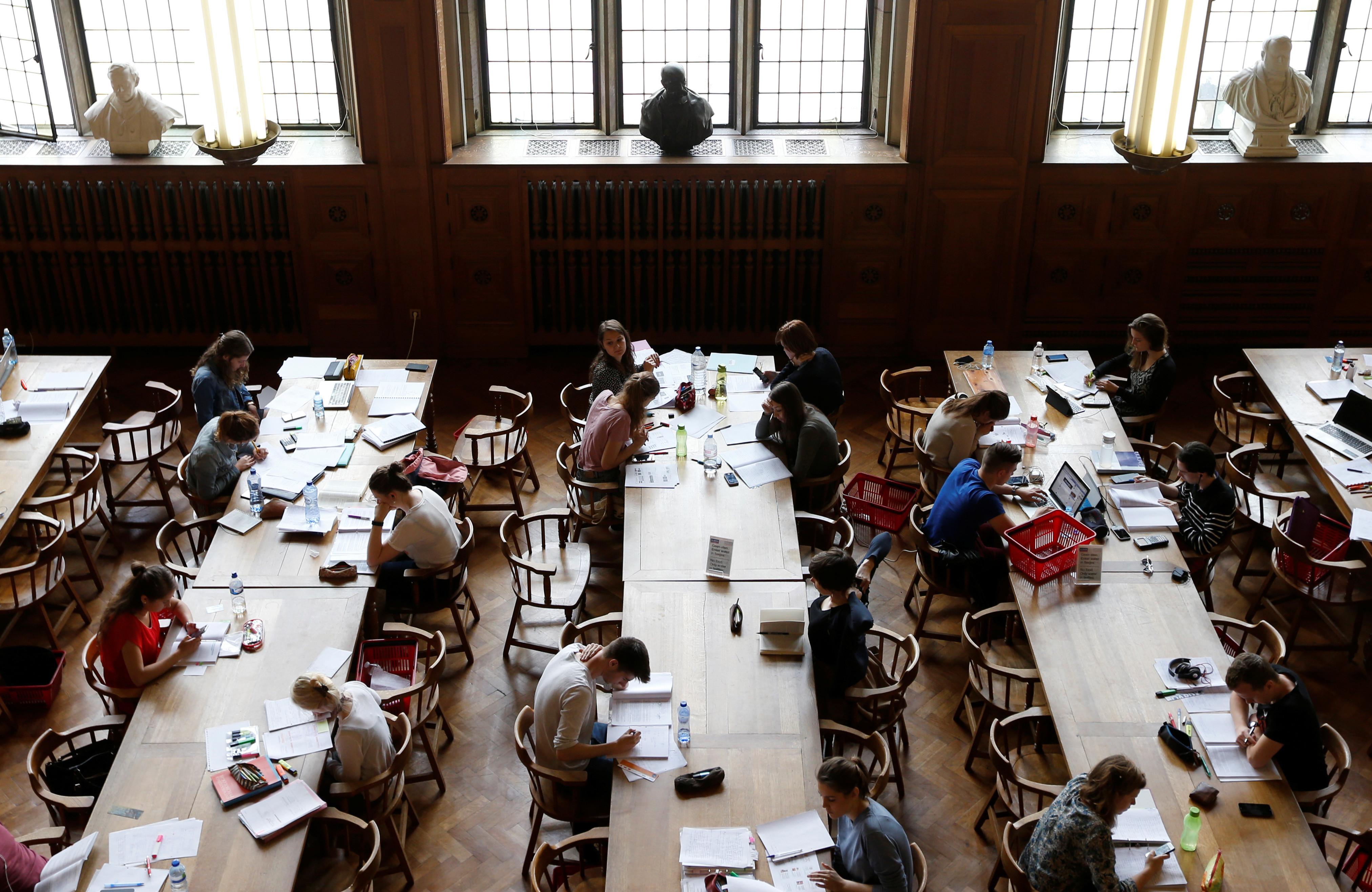 "Students sit in the library of the university KU Leuven ""Katholieke Universiteit Leuven"" in Leuven, Belgium, June 8, 2016. REUTERS/Francois Lenoir - D1AETIXBEXAA"