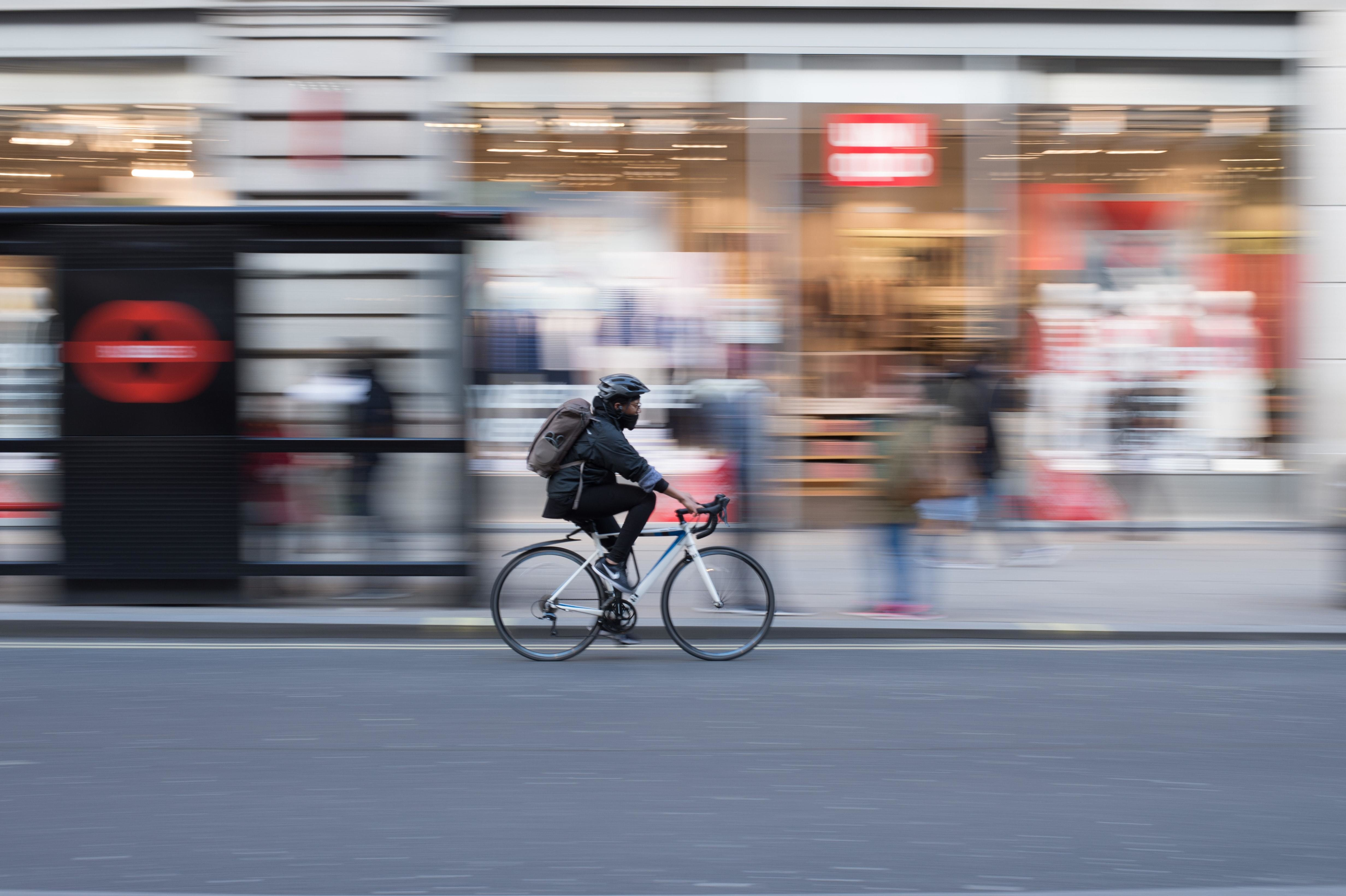 image of a person riding a bike and wearing a mask