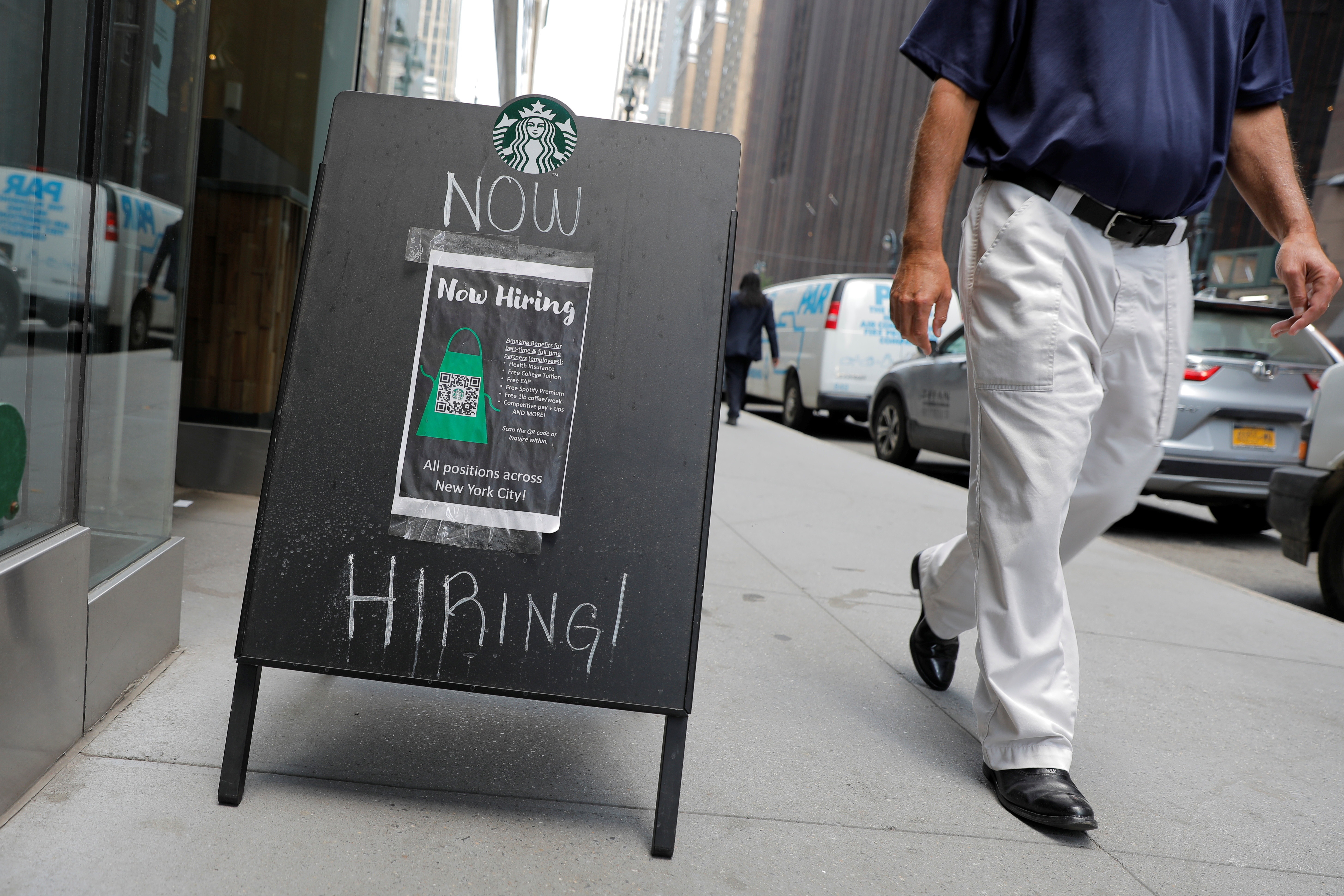 A sign advertising job openings is seen outside of a Starbucks in Manhattan, New York City, New York, U.S., May 26, 2021. REUTERS/Andrew Kelly - RC2SNN93868V