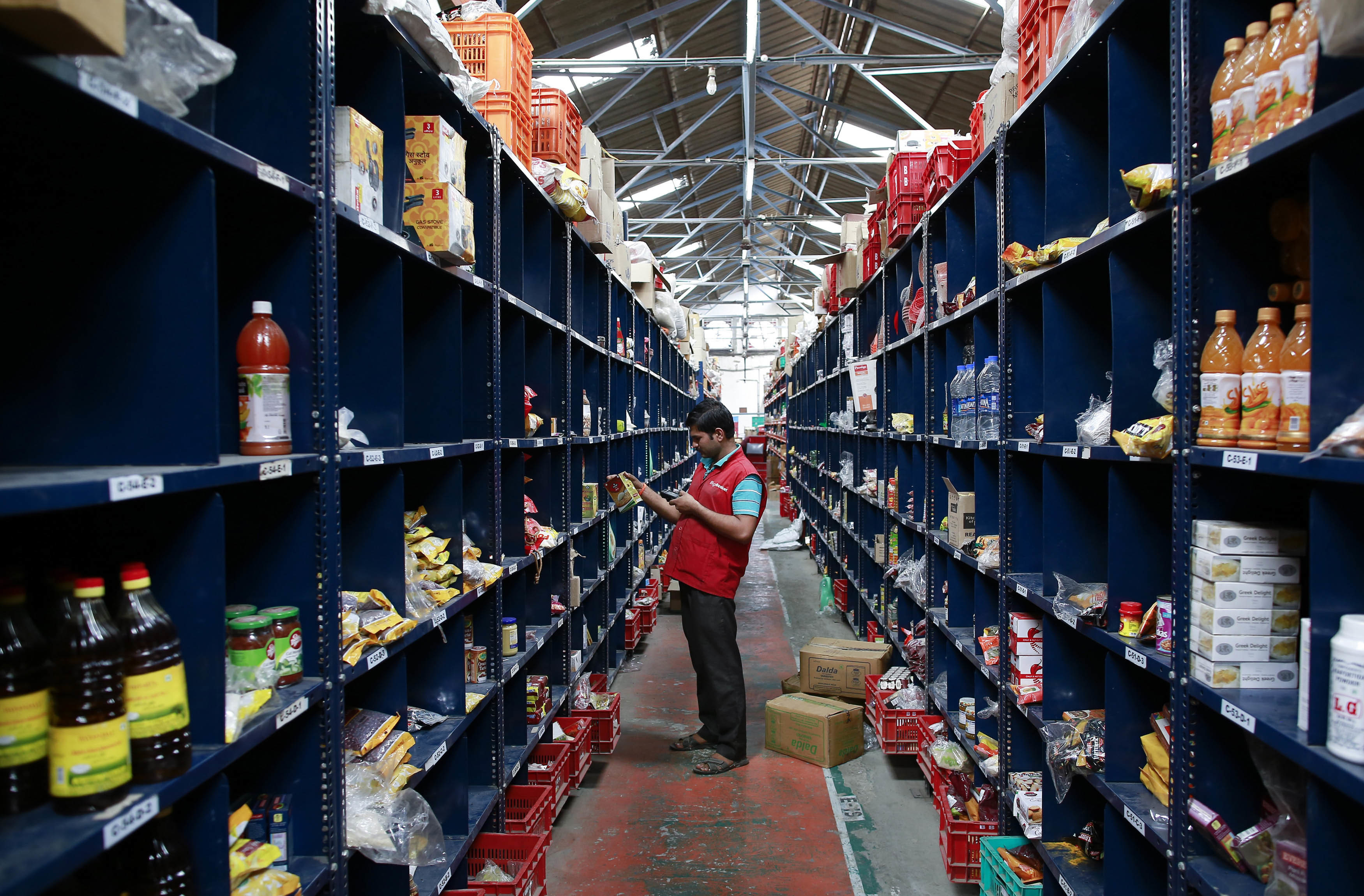 an packer in a warehouse scans an item a customer has ordered online ordered online