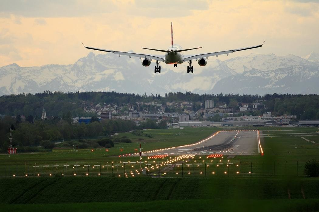 An aeroplane is taking off from an airport in Zurich.