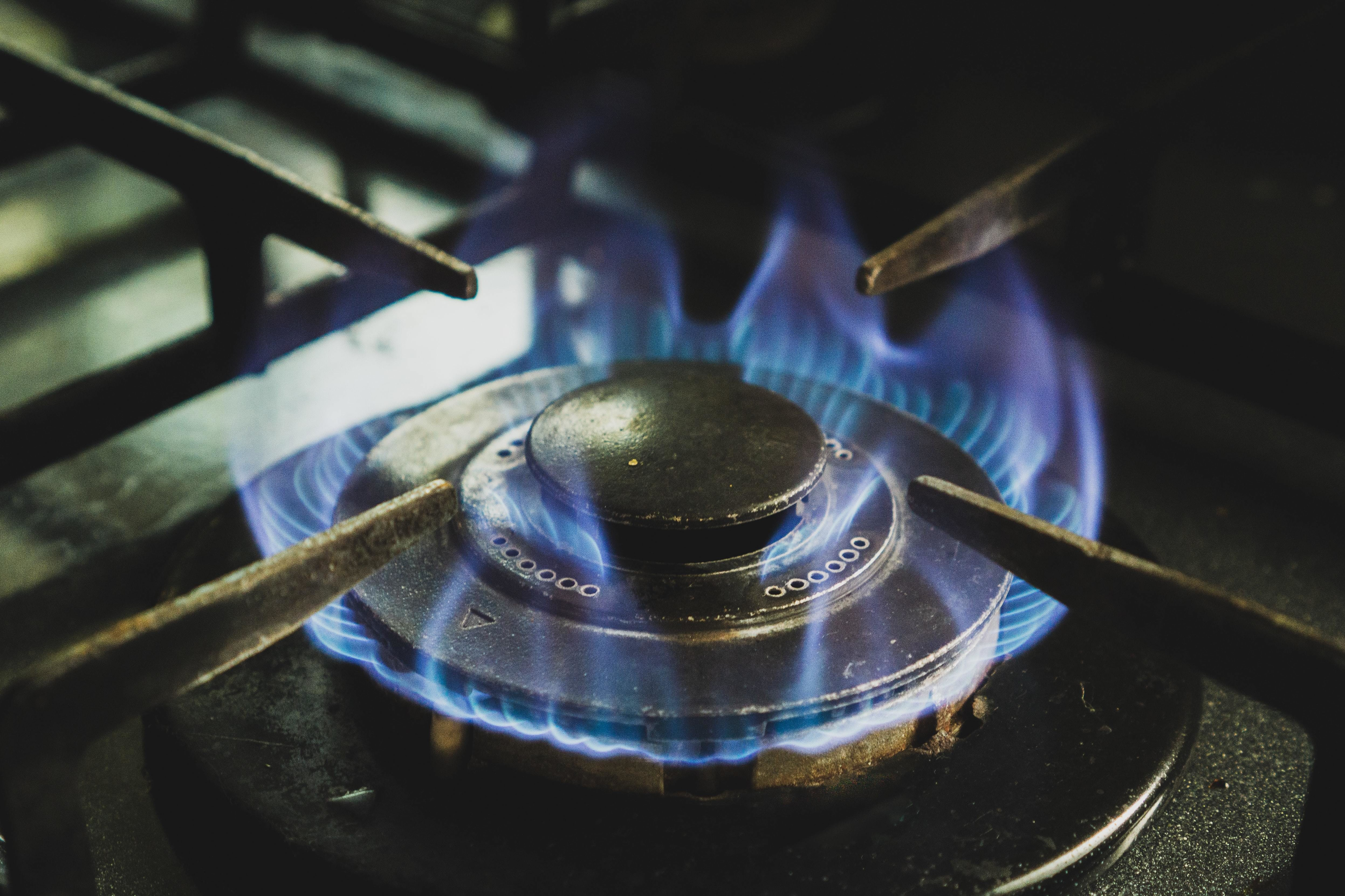 An old gas stove on fire.