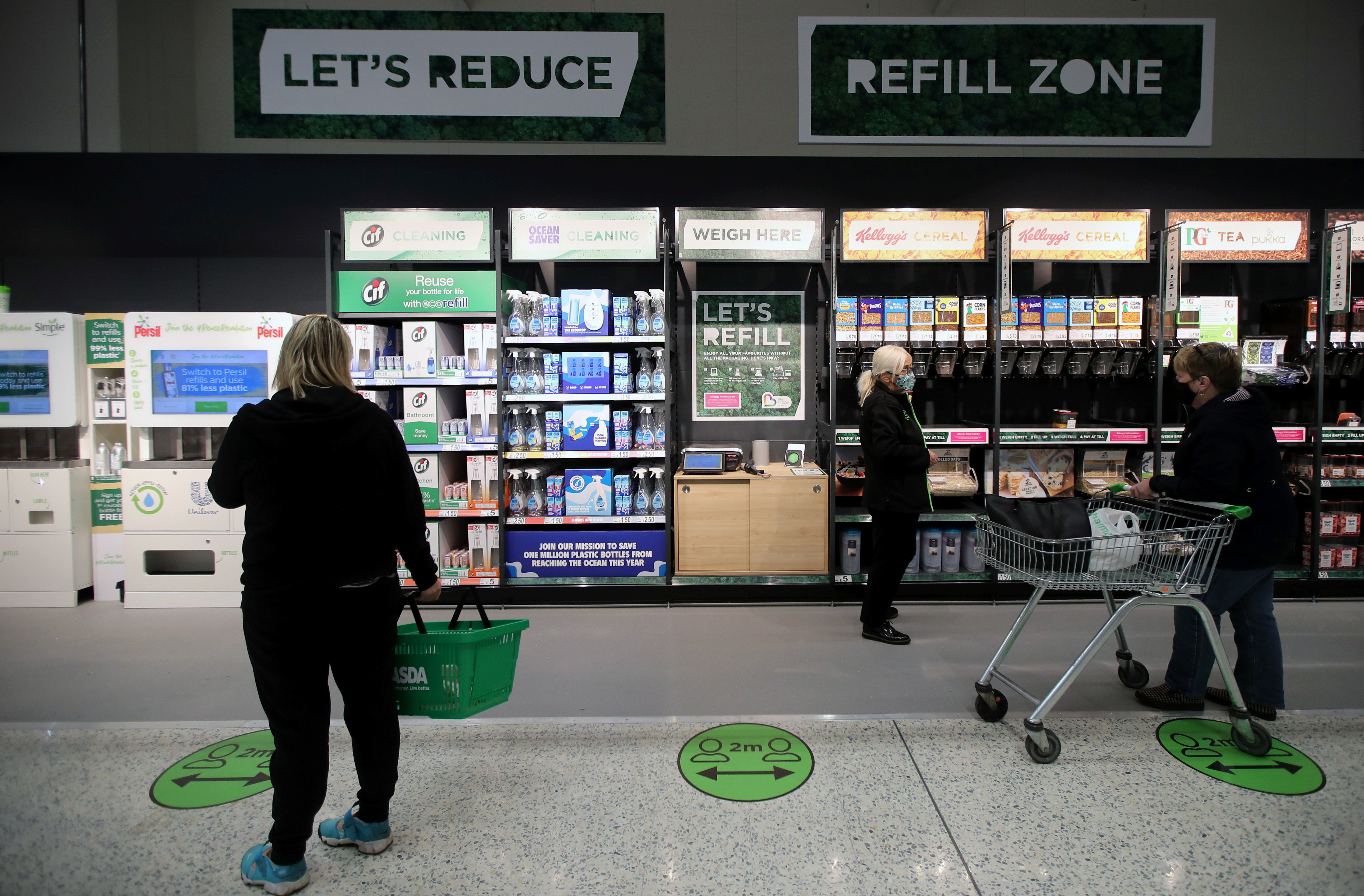 The 'Refill Zone' is seen in the UK supermarket Asda, as the store launches a new sustainability strategy, in Leeds, Britain, October 19, 2020. Picture taken October 19, 2020. REUTERS/Molly Darlington - RC27MJ9NR2B9
