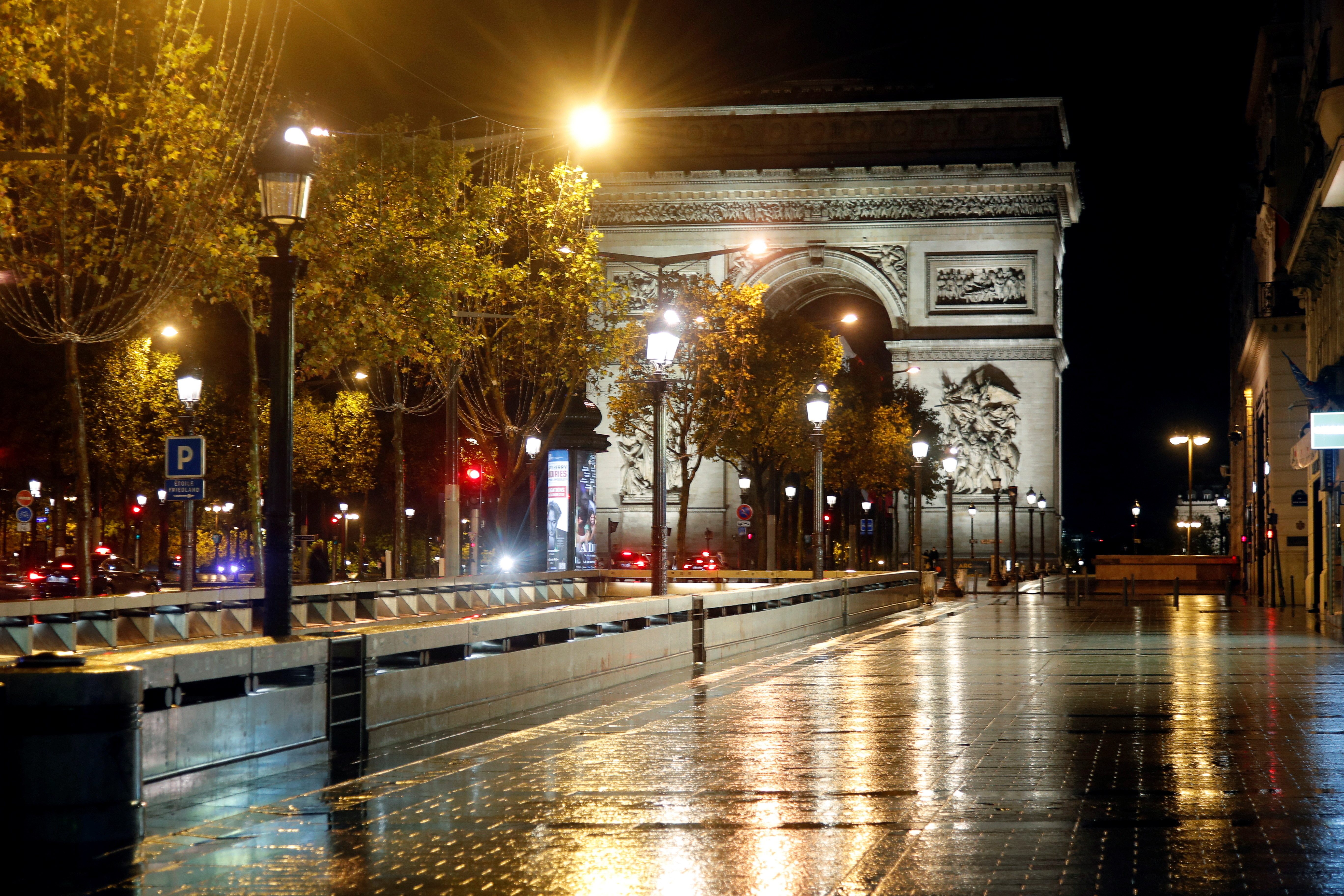 A deserted Champs-Elysees avenue is seen near the Arc de Triomphe in france during the covid curfew lockdown