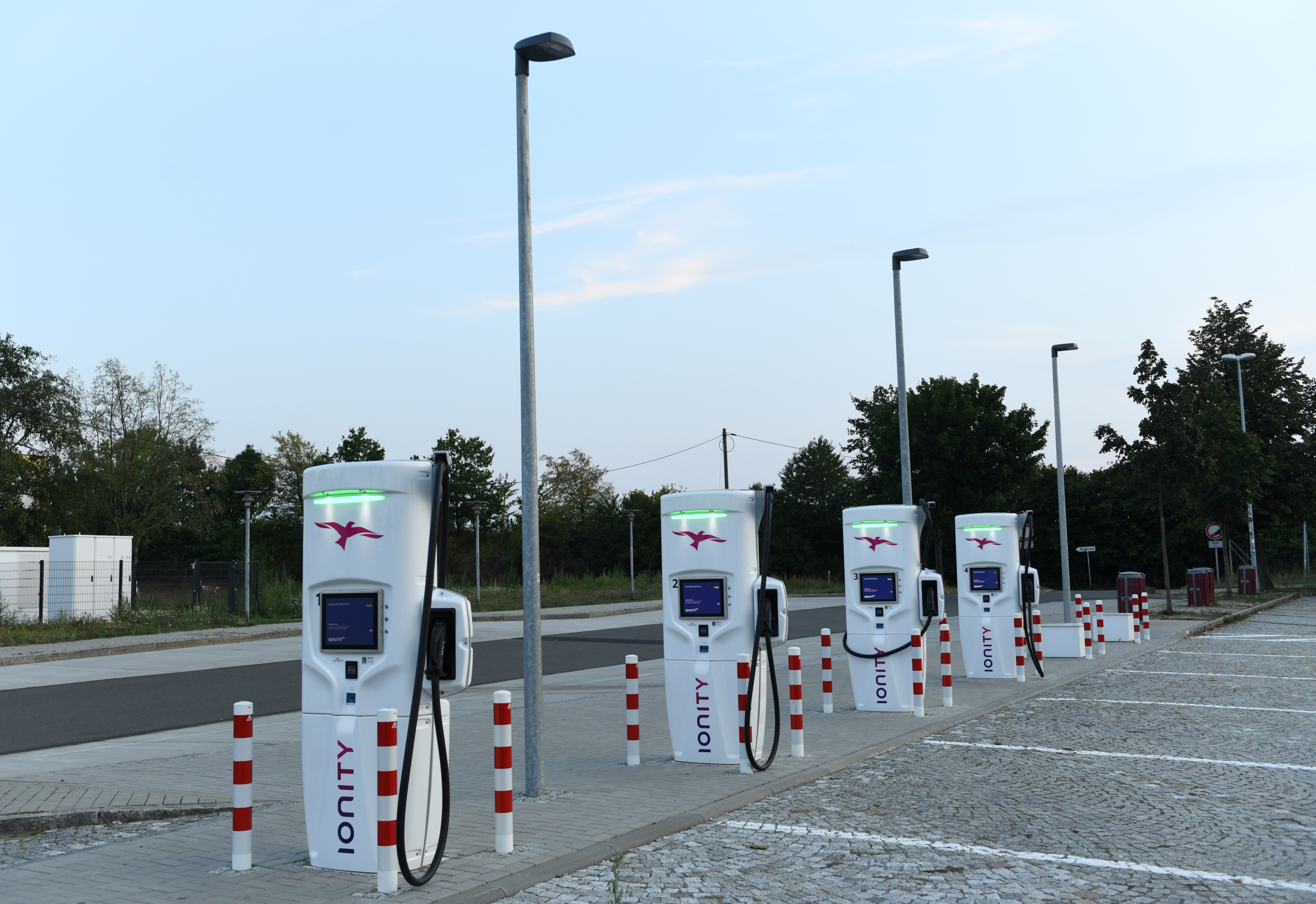 """An Ionity electric vehicle charging station is pictured on the motorway service station """"Dresdner Tor Sued"""" near Dresden, Germany, August 27, 2019. Picture taken August 27, 2019.     REUTERS/Annegret Hilse - RC14AB0EBC30"""