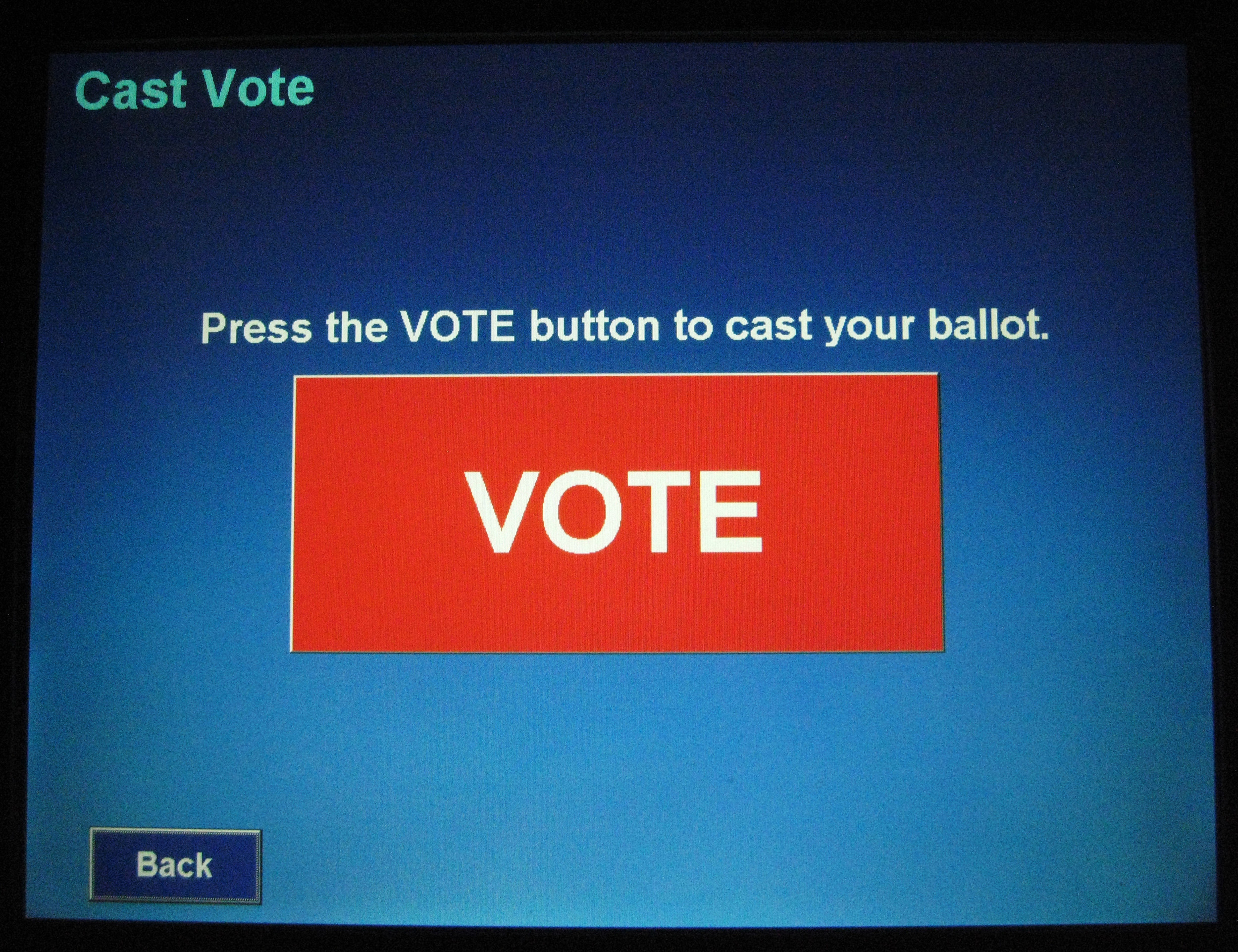 "A Touch Screen Voting Machine displays the final button to complete casting a ballot at a ""In-Person Absentee Voting"" location at McLean Governmental Center in McLean, Virginia, U.S. on October 25, 2008.   REUTERS/Hyungwon Kang/File Photo - TM3EC980XVB01"