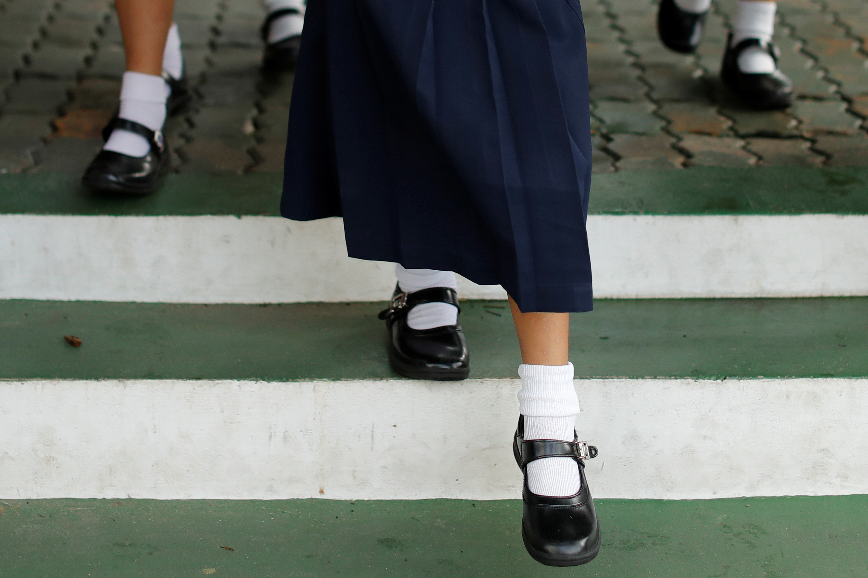 Thai girls walk inside a school wearing school uniforms that are mandatory in the country, in Bangkok, Thailand September 15, 2020. Picture taken September 15, 2020. REUTERS/Jorge Silva - RC218J9G3IFJ