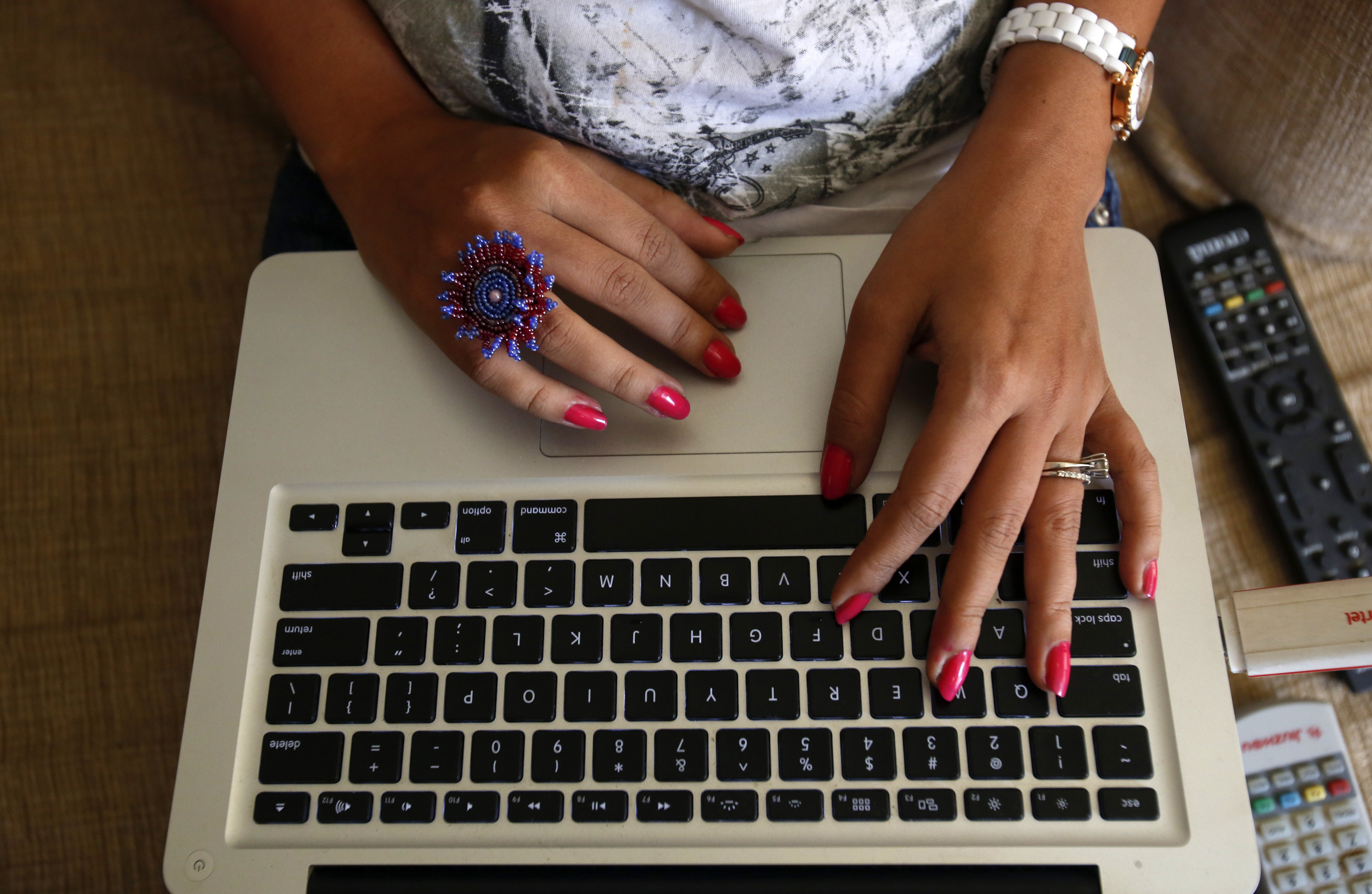"The hands of Malini Agarwal, blogger-in-chief of missmalini.com, are pictured as she blogs from her living room in Mumbai, January 22, 2013. Agarwal, 35, exemplifies what aspirational India is all about - She's bubbly, energetic, and describes herself as ""India's blogging princess"" and a ""social media Jedi"". She's been called ""without a doubt, India's most famous blogger"". Her blog, missmalini.com, gets over 250,000 unique visitors a month. It provides a steady diet of Bollywood gossip, fashion, food and entertainment to a legion of followers. REUTERS/Vivek Prakash (INDIA) - LM2E92B13VR01"