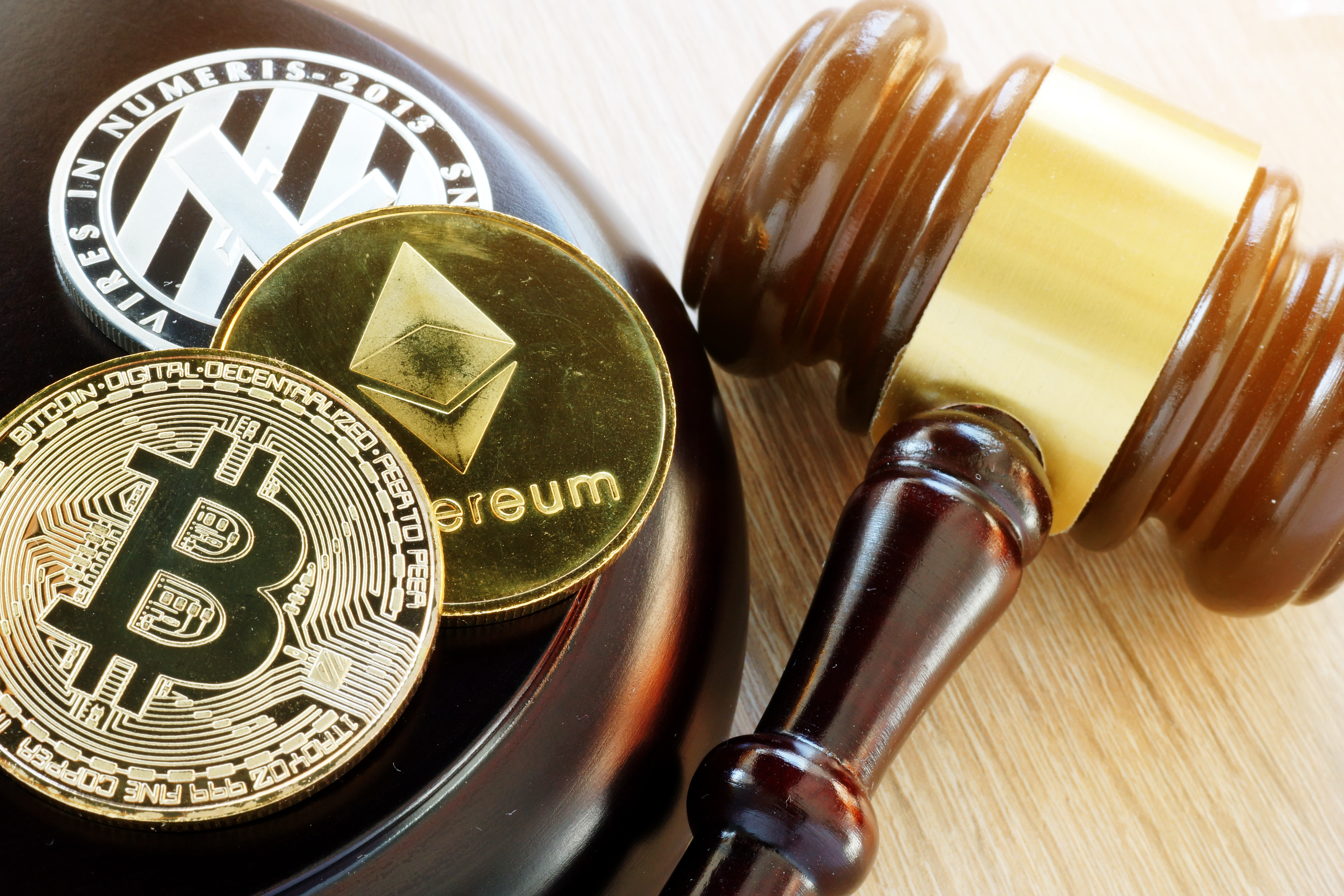Gavel and cryptocurrency tokens; government regulation.
