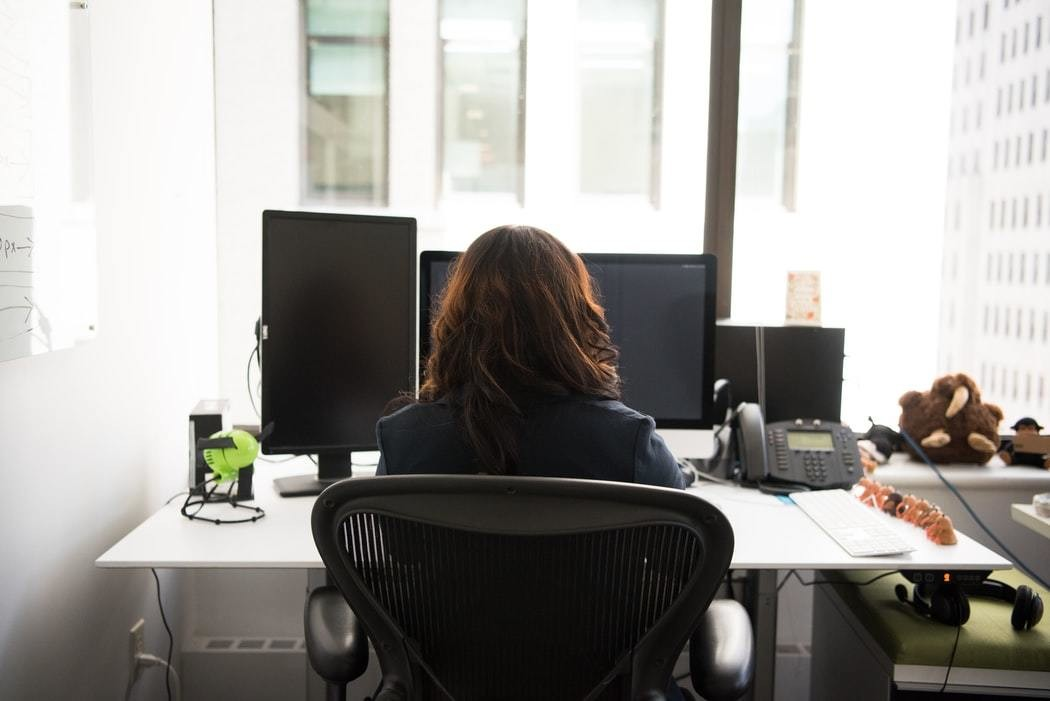 image of a woman working at a computer