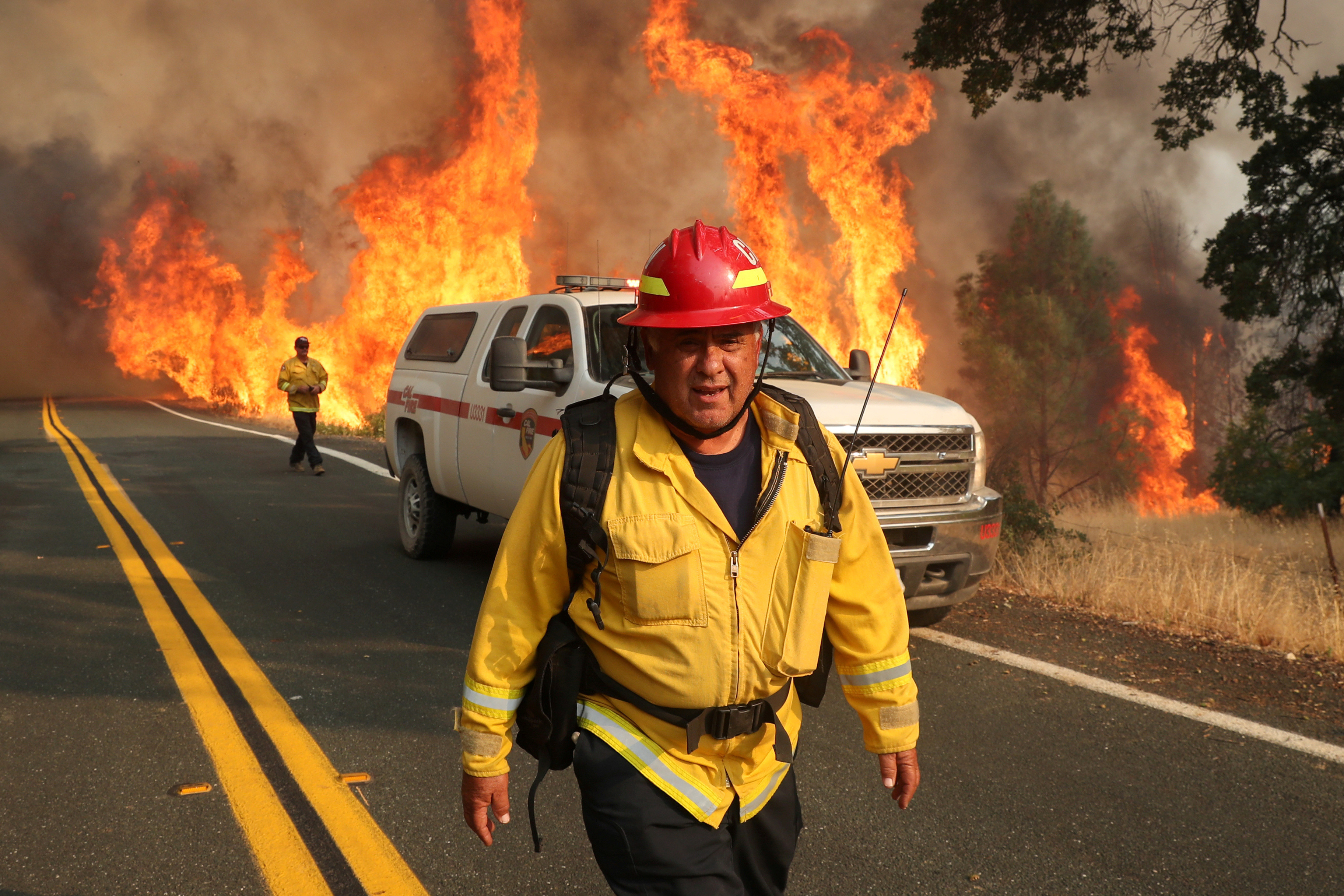 Chula Vista firefighter Rudy Diaz monitors the LNU Lightning Complex Fire as it engulfs brush in Lake County, California, U.S. August 23, 2020.