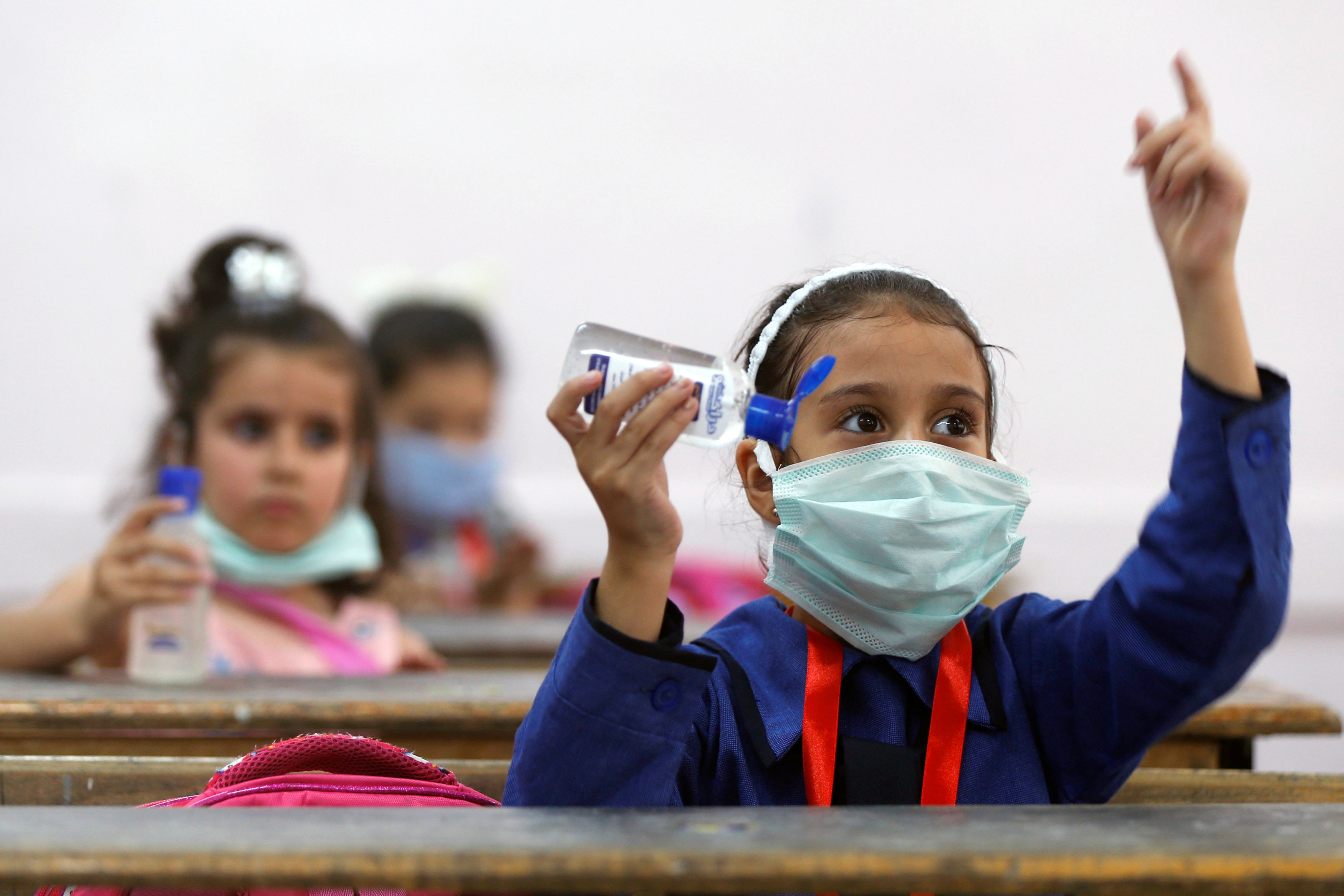 Refugee students learn how to sanitise their hands on the first day of the new school year at one of the UNRWA schools, amid fears of rising numbers of the coronavirus disease (COVID-19) cases in Amman, Jordan September 1, 2020