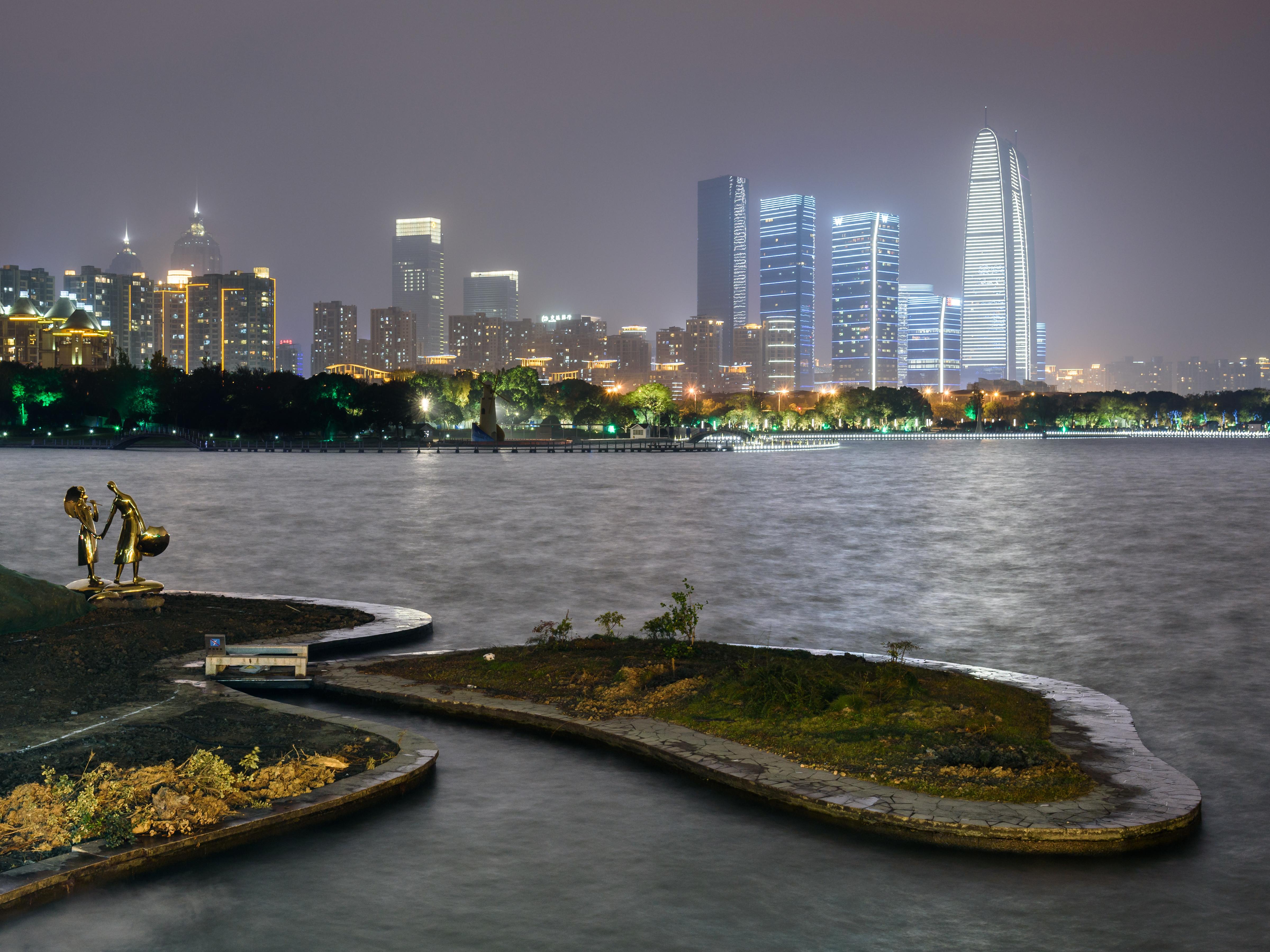 City skyline across Jinji Lake, Suzhou, China.