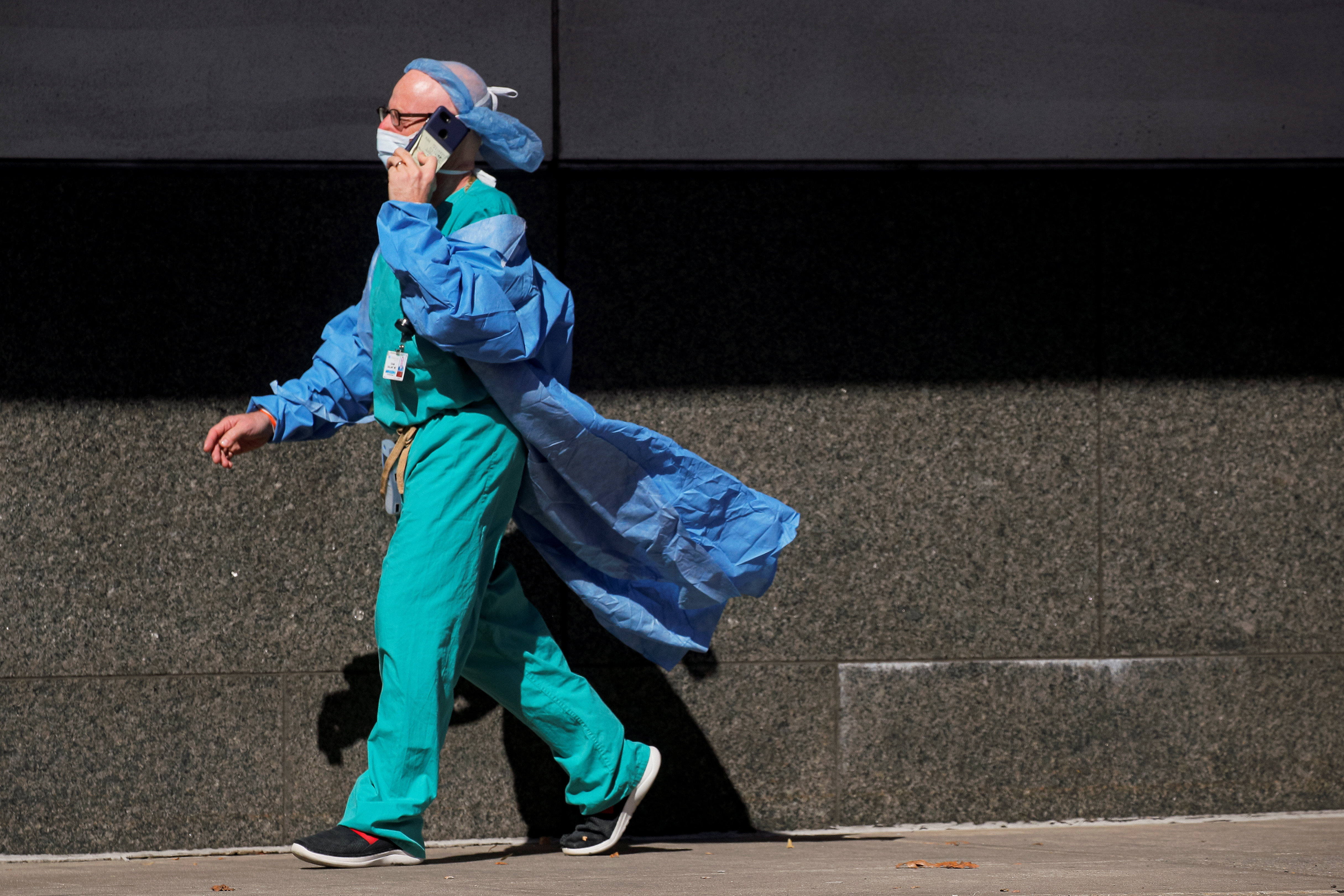 A doctor speaks on his phone outside the Emergency entrance to Maimonides Medical Center, as the spread of the coronavirus disease (COVID-19) continues, in the Borough Park neighborhood of Brooklyn, New York, U.S., October 14, 2020.  REUTERS/Brendan McDermid - RC2OIJ9HBHCR