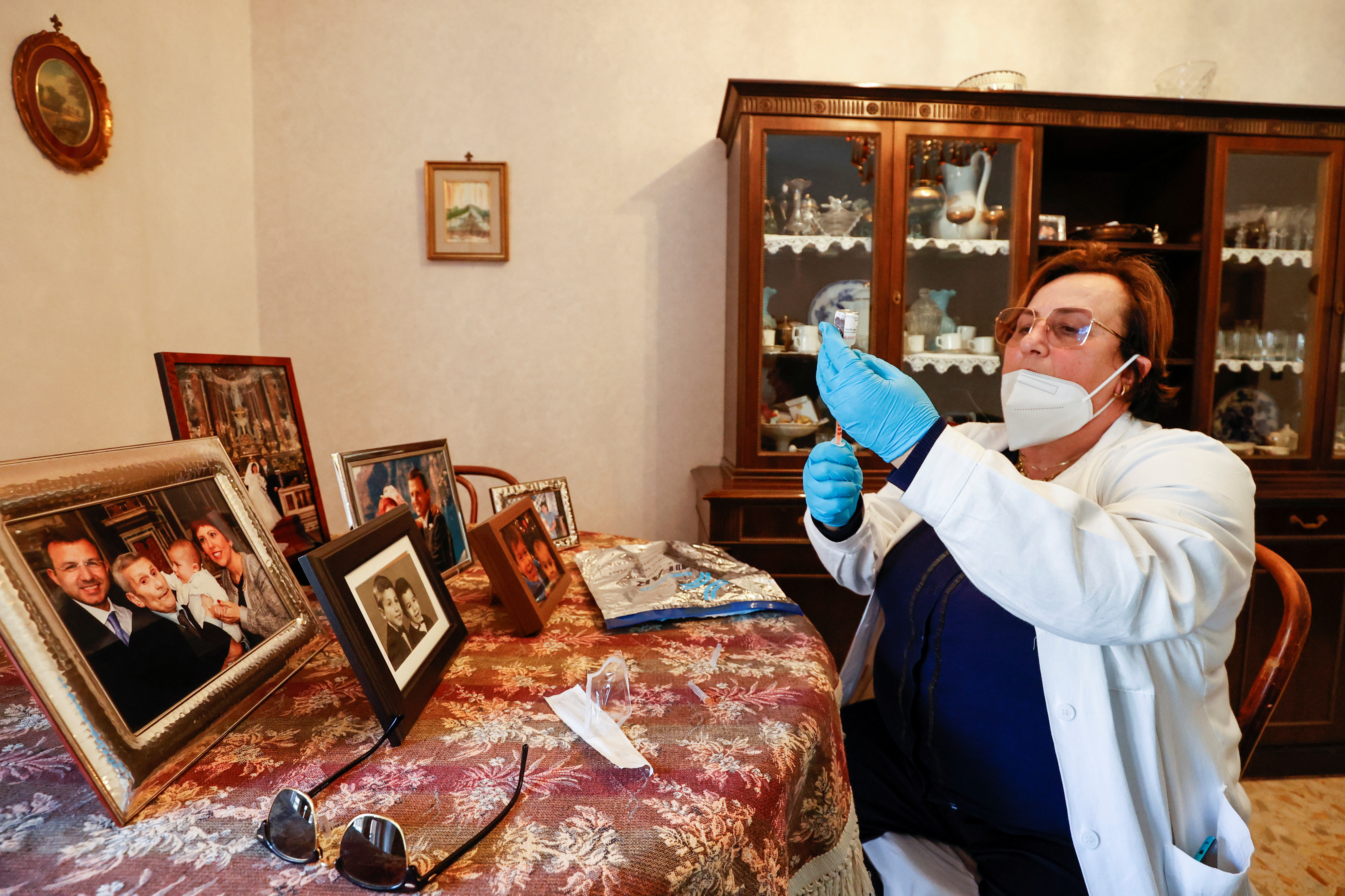 image of doctor Pina Tomaselli prepares a syringe containing a dose of the Moderna coronavirus disease (COVID-19) vaccine at a care home in Naples, Italy