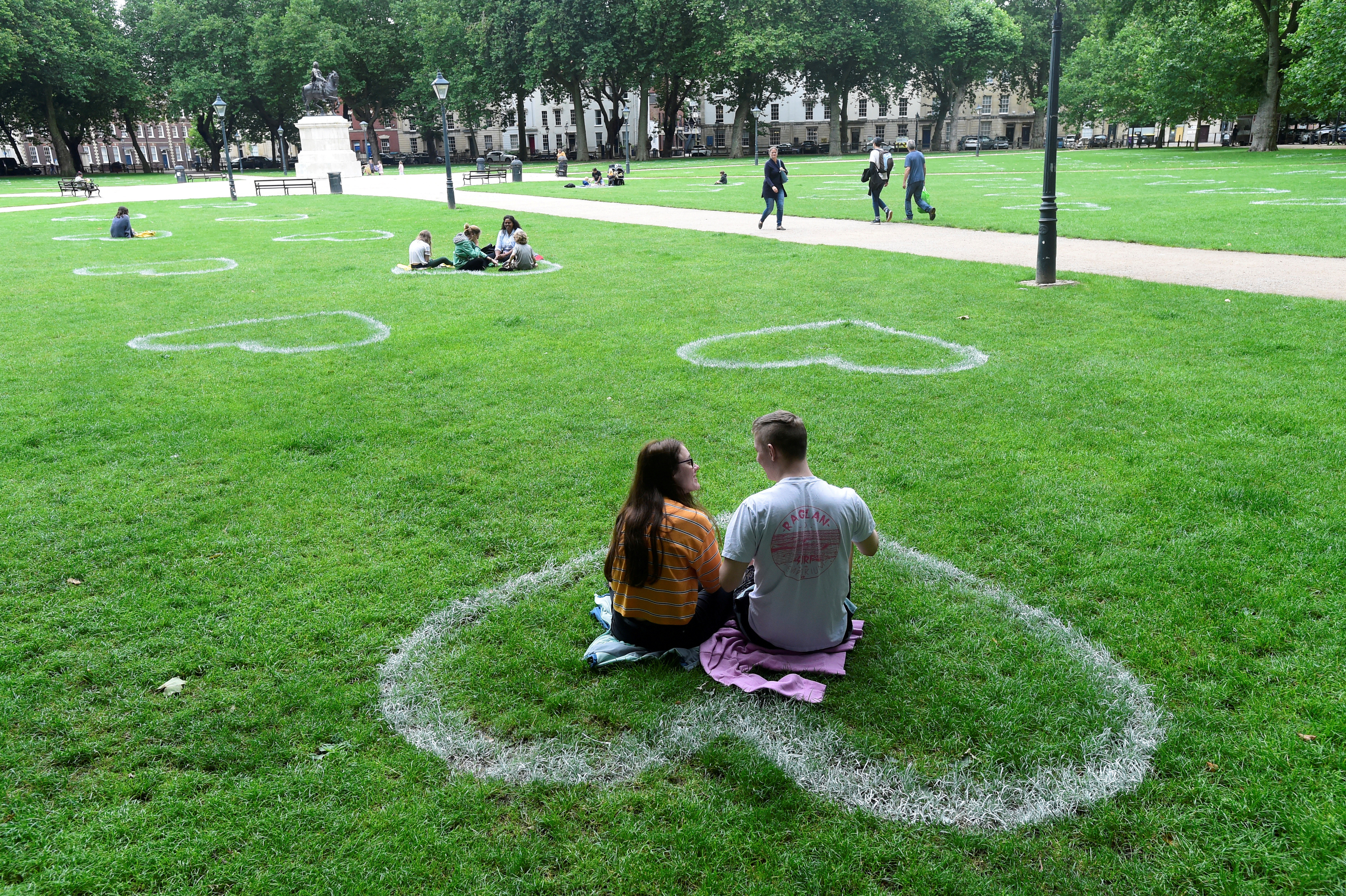 Hearts painted by a team of artists from Upfest are seen in the grass at Queen Square, following the coronavirus disease (COVID-19) outbreak, in Bristol, Britain July 8, 2020. REUTERS/Rebecca Naden     TPX IMAGES OF THE DAY - RC21PH9XFK8Q