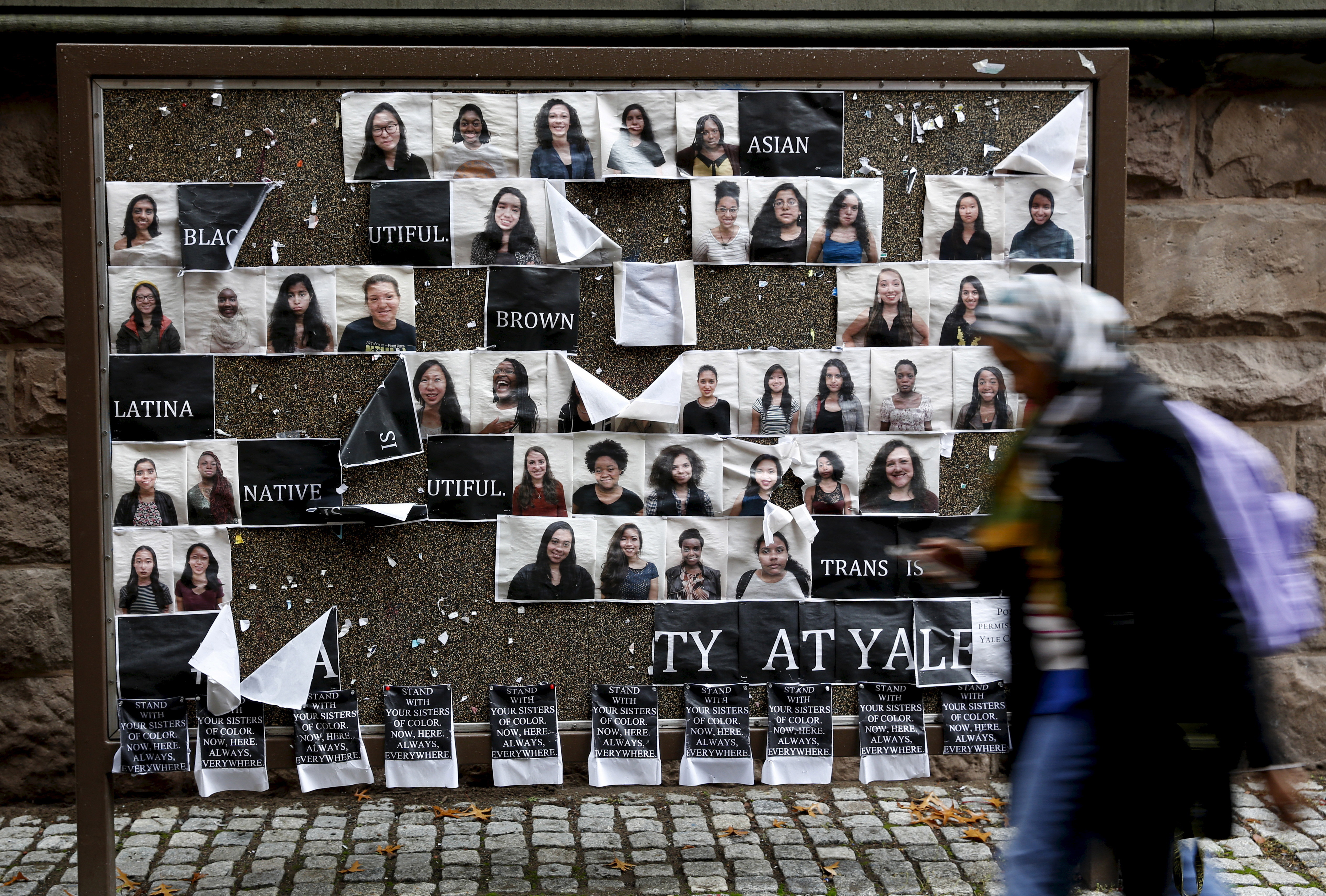 A student walks by a college noticeboard on campus at Yale University in New Haven, Connecticut November 12, 2015. More than 1,000 students, professors and staff at Yale University gathered on Wednesday to discuss race and diversity at the elite Ivy League school, amid a wave of demonstrations at U.S. colleges over the treatment of minority students. REUTERS/Shannon Stapleton - GF20000057014