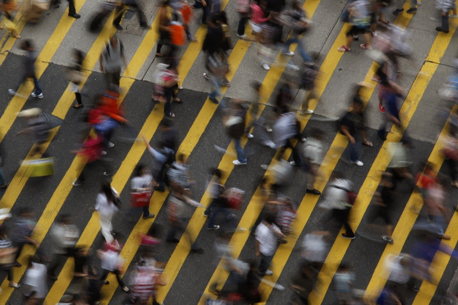 ATTENTION EDITORS - IMAGE 1 OF 22 OF PICTURE PACKAGE '7 BILLION, 7 STORIES - OVERCROWDED IN HONG KONG. SEARCH 'MONG KOK' FOR ALL IMAGES - People cross a street in Mong Kok district in Hong Kong, October 4, 2011. Mong Kok has the highest population density in the world, with 130,000 in one square kilometre. The world's population will reach seven billion on 31 October 2011, according to projections by the United Nations, which says this global milestone presents both an opportunity and a challenge for the planet. While more people are living longer and healthier lives, says the U.N., gaps between rich and poor are widening and more people than ever are vulnerable to food insecurity and water shortages.   Picture taken October 4, 2011.   REUTERS/Bobby Yip   (CHINA - Tags: SOCIETY) - RTR2SQJP