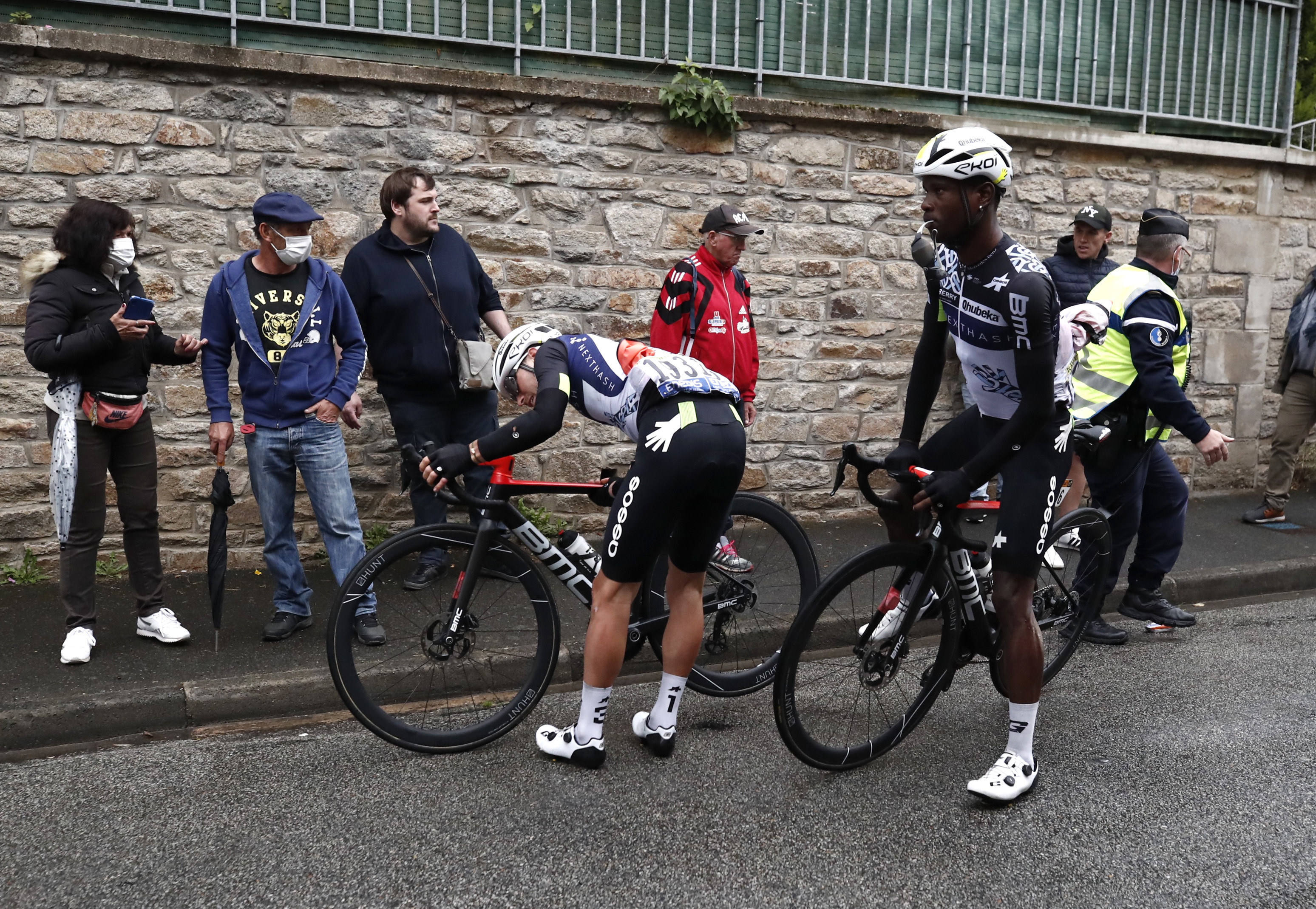 Cycling - Tour de France - Stage 3 -  Lorient to Pontivy - France - June 28, 2021 Team Qhubeka NextHash rider Sean Bennett of the U.S. and rider Nic Dlamini of South Africa stopped to check the bike during stage 3