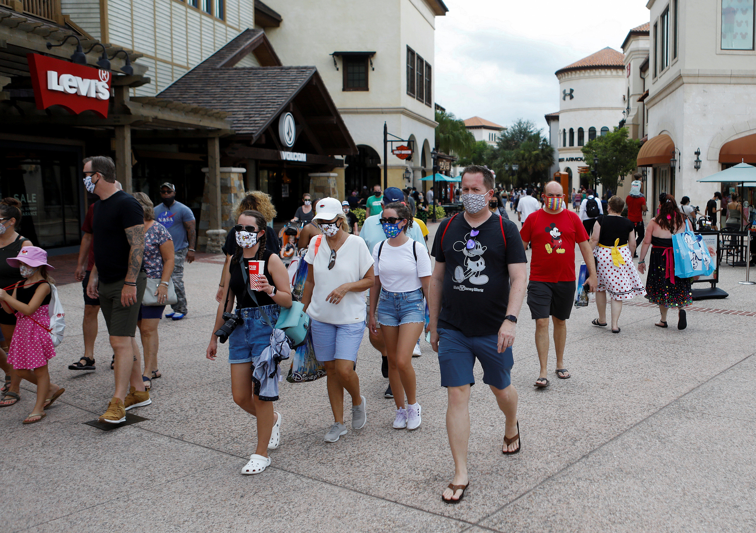 Disney Springs shoppers wear face masks and Disney-themed clothing while Walt Disney World conducts a phased reopening from coronavirus disease (COVID-19) restrictions in Lake Buena Vista, Florida, U.S. July 11, 2020. REUTERS/Octavio Jones - RC28RH91SW04