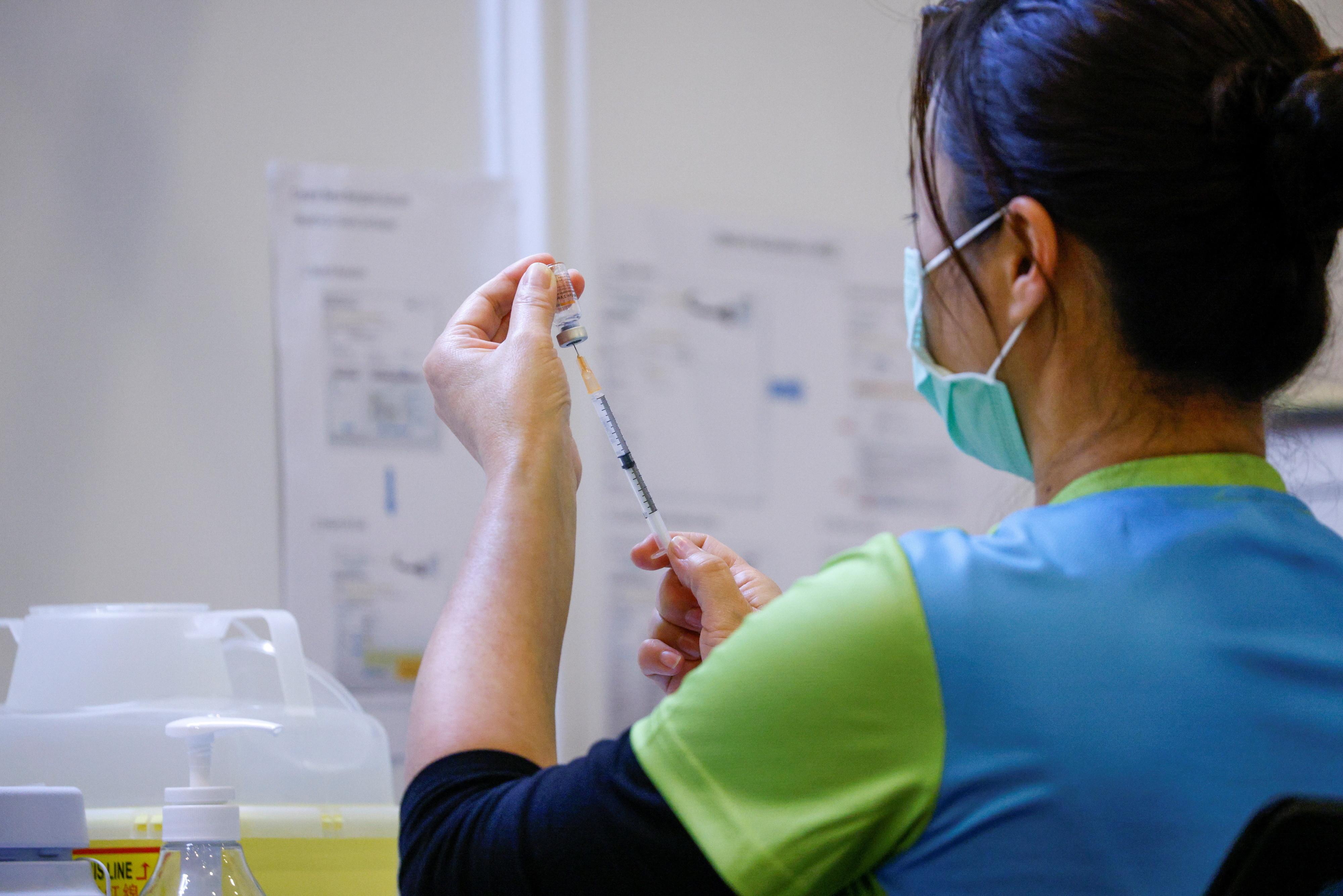 image of a nurse preparing the COVID-19 vaccine