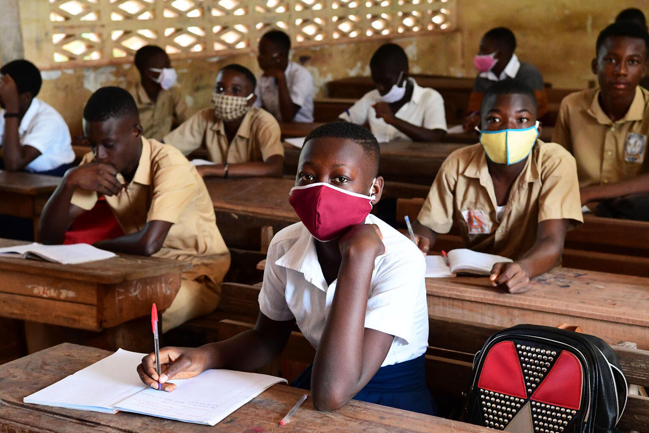 """Emira Dialo, a 15 years old girl at her school in San Pedro, in the South West of Côte d'Ivoire. Emira says: """"I am very happy to be back at school today. I missed my friends and I was bored at home. Fortunately, we can still take exams after all, and we don't have to retake the school year. I did the one line school program but it's not the same. At school I learn better. My dream is to become a doctor pharmacist.""""Due to COVID-19, the schools were closed for several weeks. Today classes started, with the necessary measures. Children wear masks, wash their hands regularly and keep a social distance.For every child, education."""