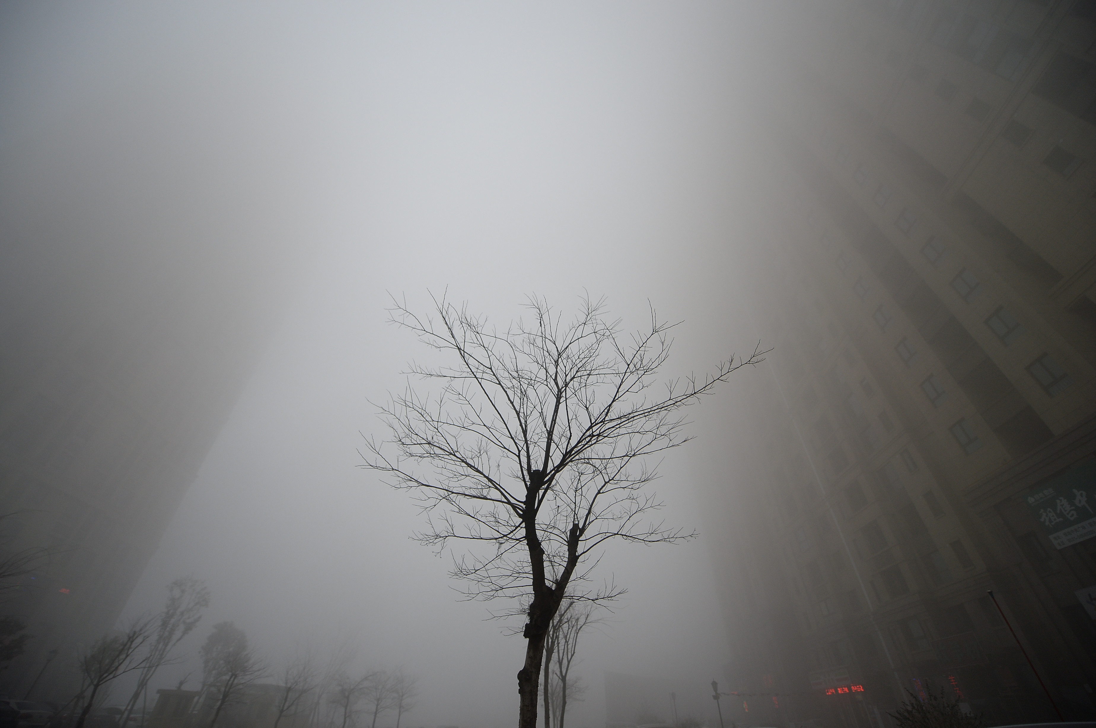 Buildings are seen in heavy smog during a polluted day