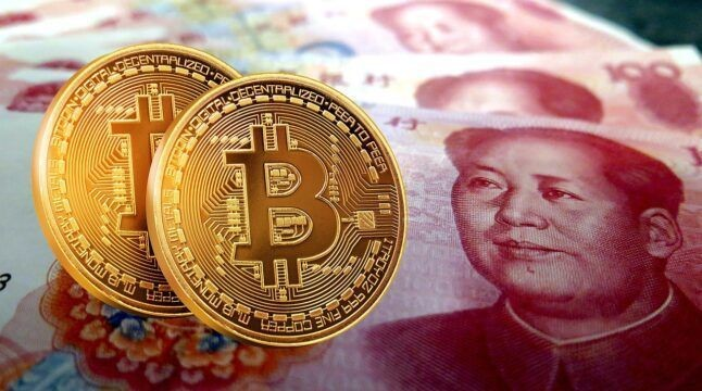 A photo of Bitcoin and a 100 renminbi note.