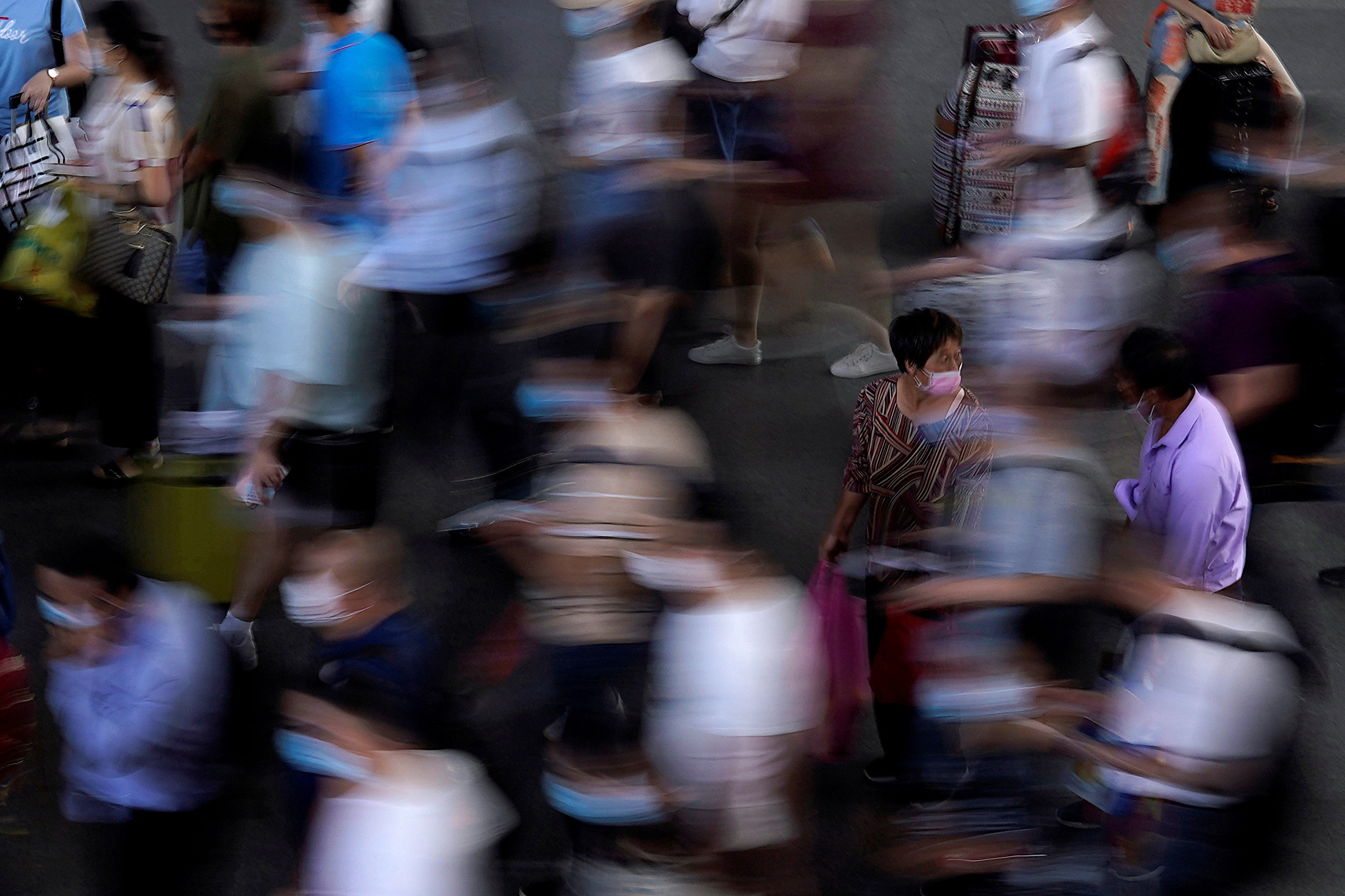 People wearing face masks wait for the train at Suzhou Railway Station, following the coronavirus disease (COVID-19) outbreak, in Suzhou, Jiangsu province, China July 7, 2020. Picture taken July 7, 2020. REUTERS/Aly Song     TPX IMAGES OF THE DAY - RC2POH9RBKOH