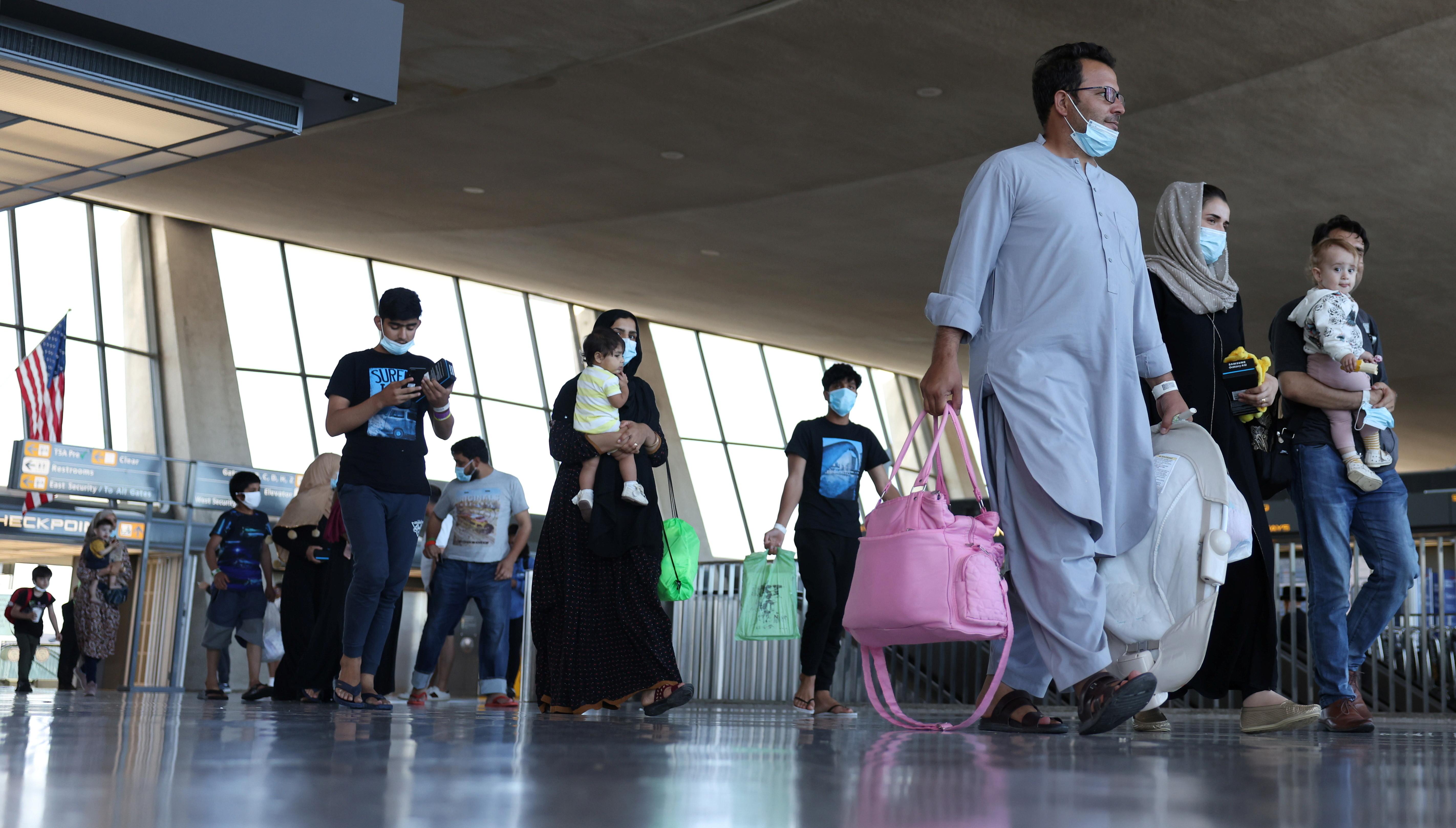 Afghan refugees arrive in Dulles, Virginia.