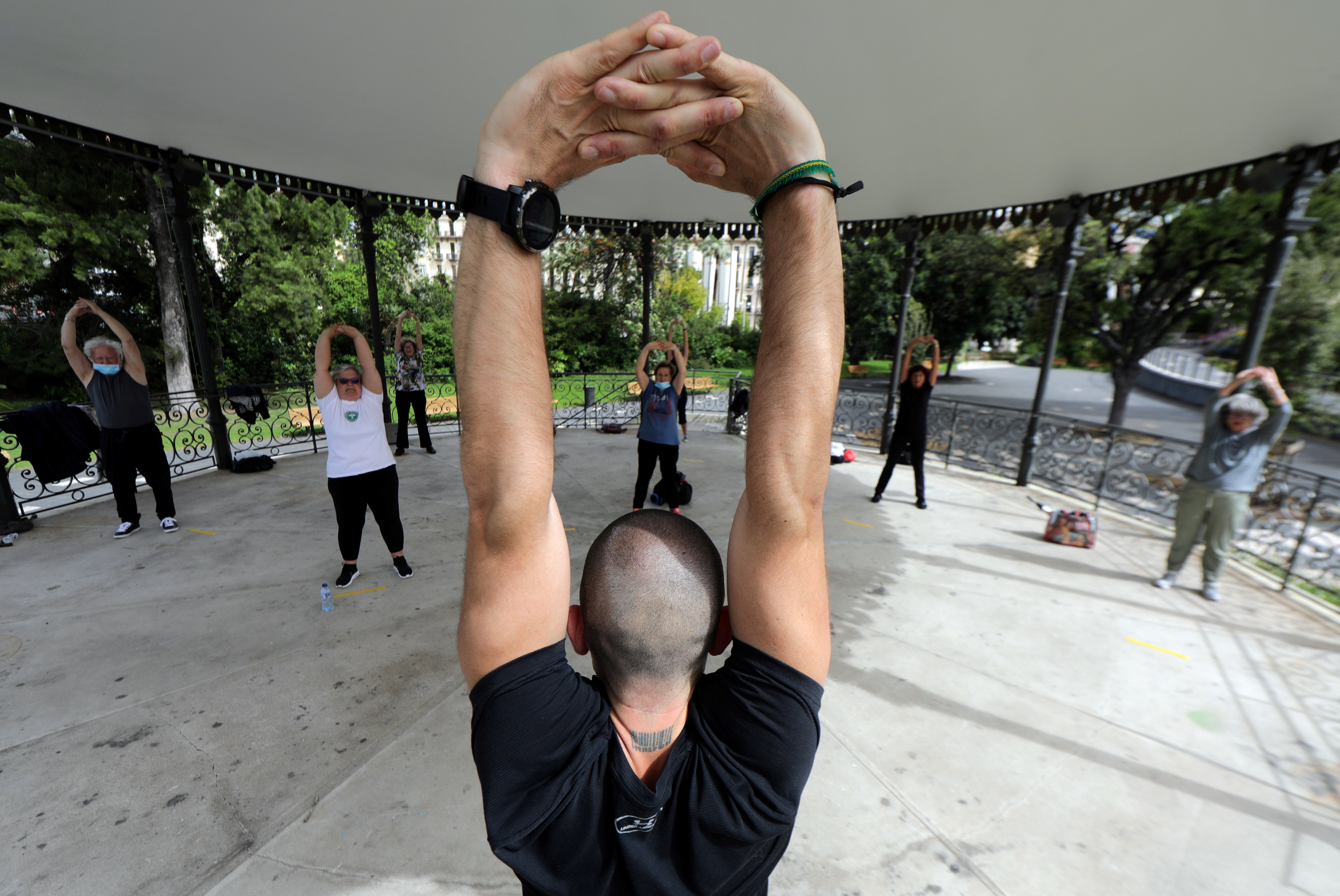 A group of elderly people practice exercise with social distancing in the bandstand of Albert 1er public garden in Nice as France softens its strict lockdown rules during the outbreak of the coronavirus disease (COVID-19) in France, May 13, 2020.   REUTERS/Eric Gaillard - RC2MNG985R7O